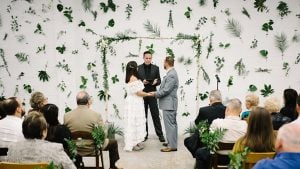 Prepare to Fall In Love With the Epic Plant Wall at this Couple's Industrial Brewery Wedding