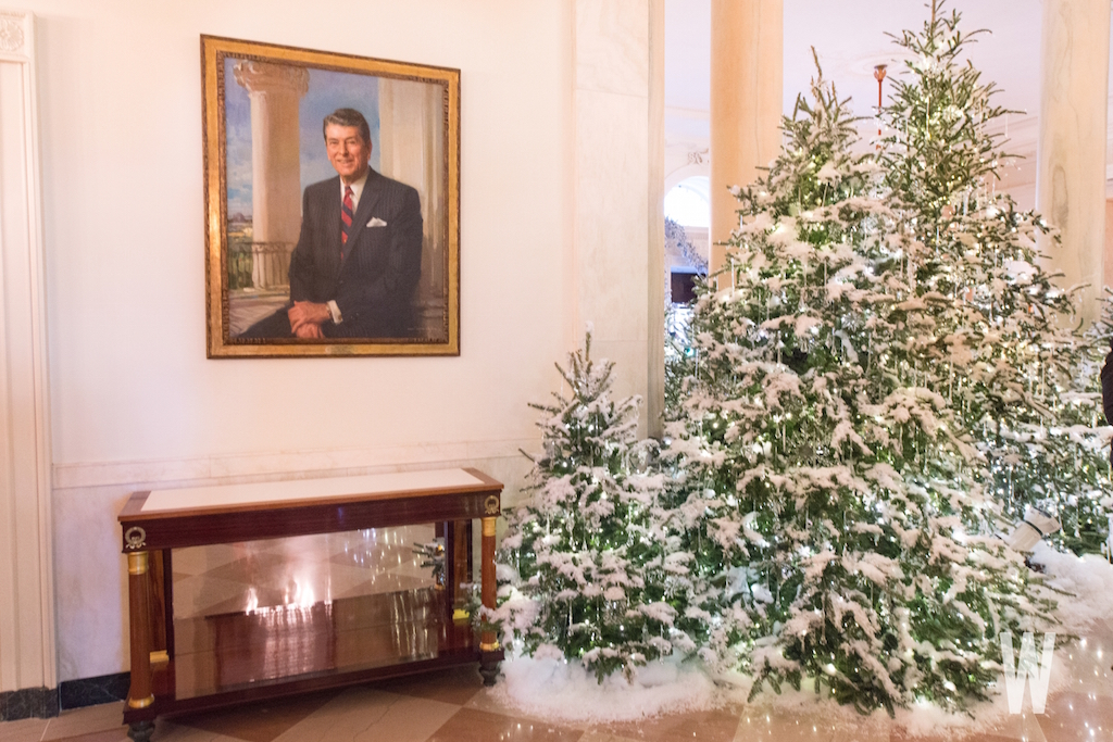 a portrait of president reagan now hangs inside the hall at the entrance to the state dining room white house christmas decorations 2017