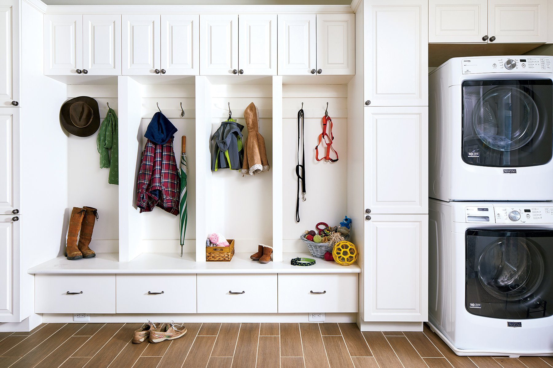 The opposite wall of Sappington's mudroom features ample built-in storage plus a washer and dryer specifically for pet blankets and towels. Photograph by Stacy Zarin Goldberg.