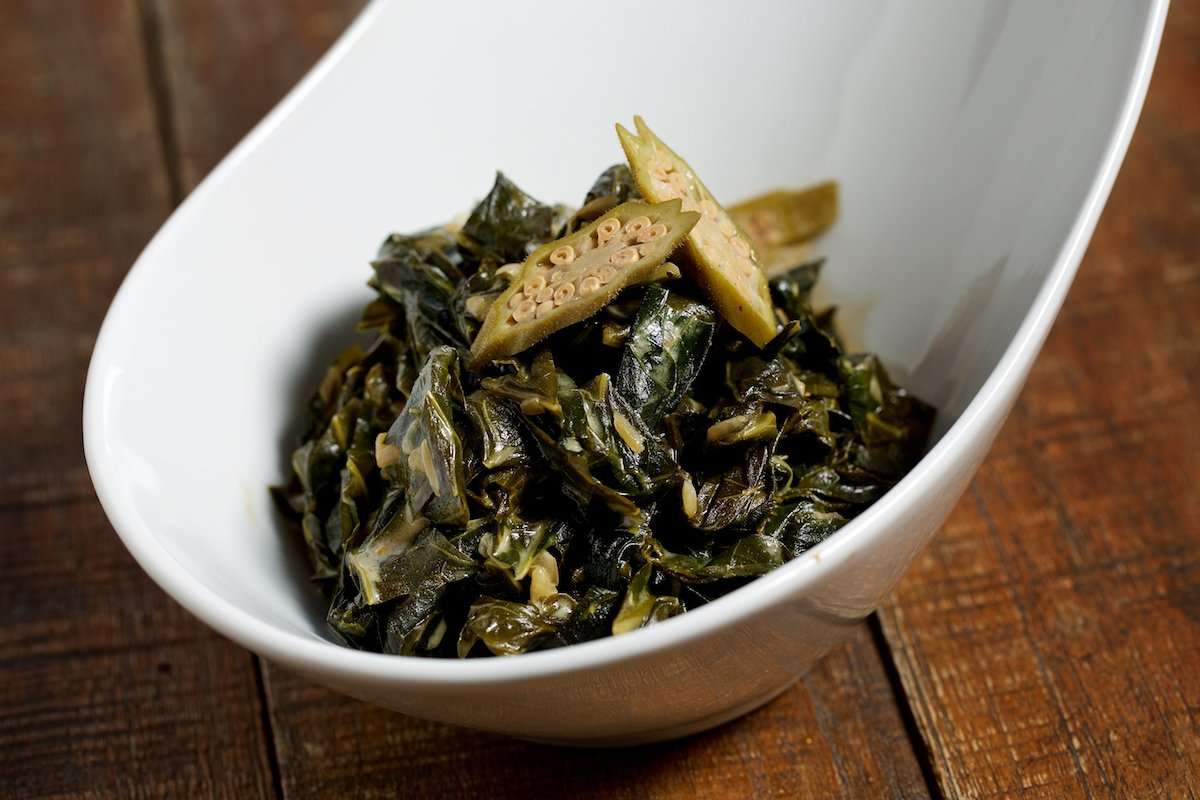 Collards with coconut are a nod to Prime's home. Photograph by Deb Lindsey.