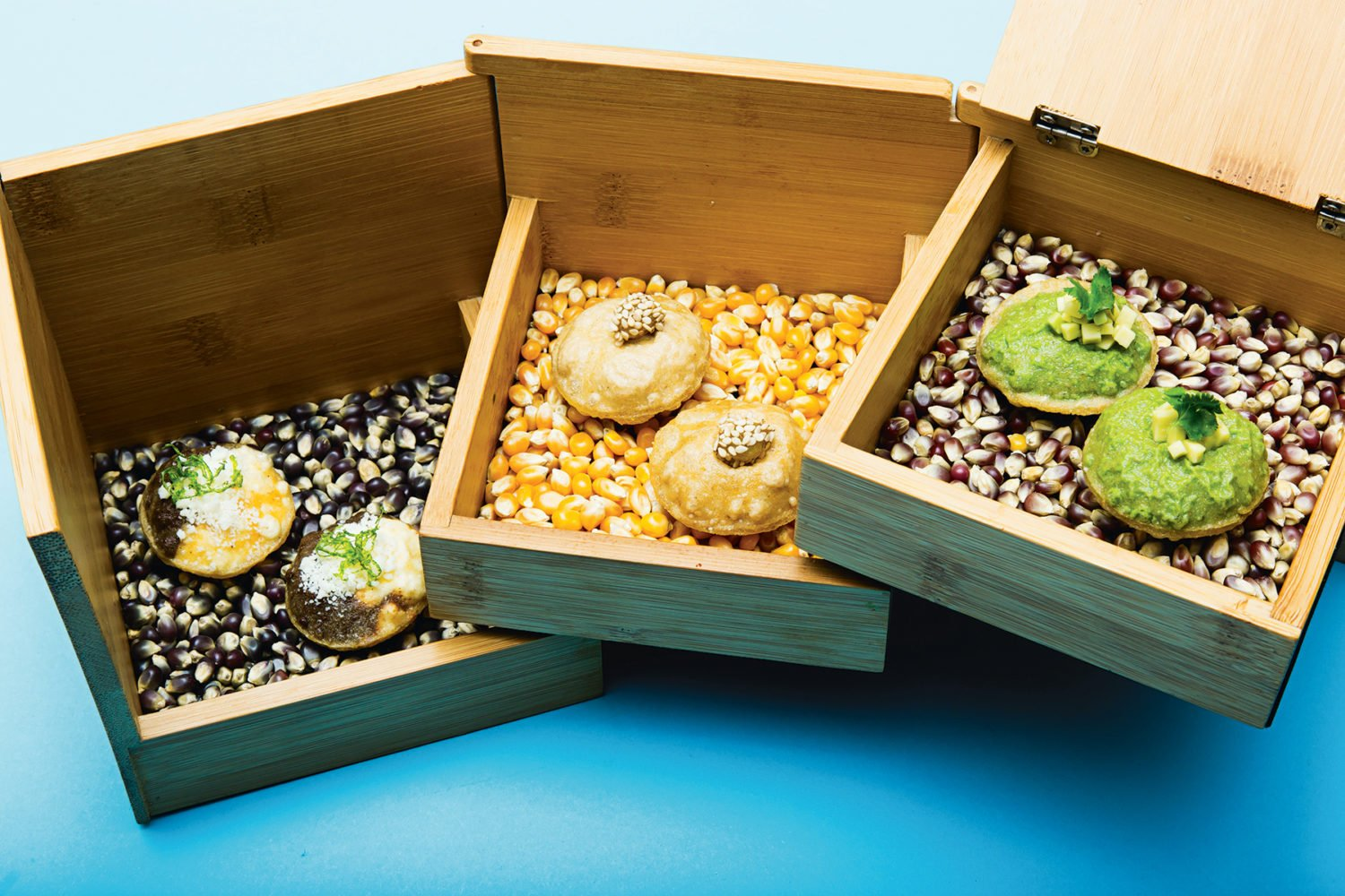 Wooden jewelry box for masa puffs at Pineapple and Pearls. Photograph by Scott Suchman.
