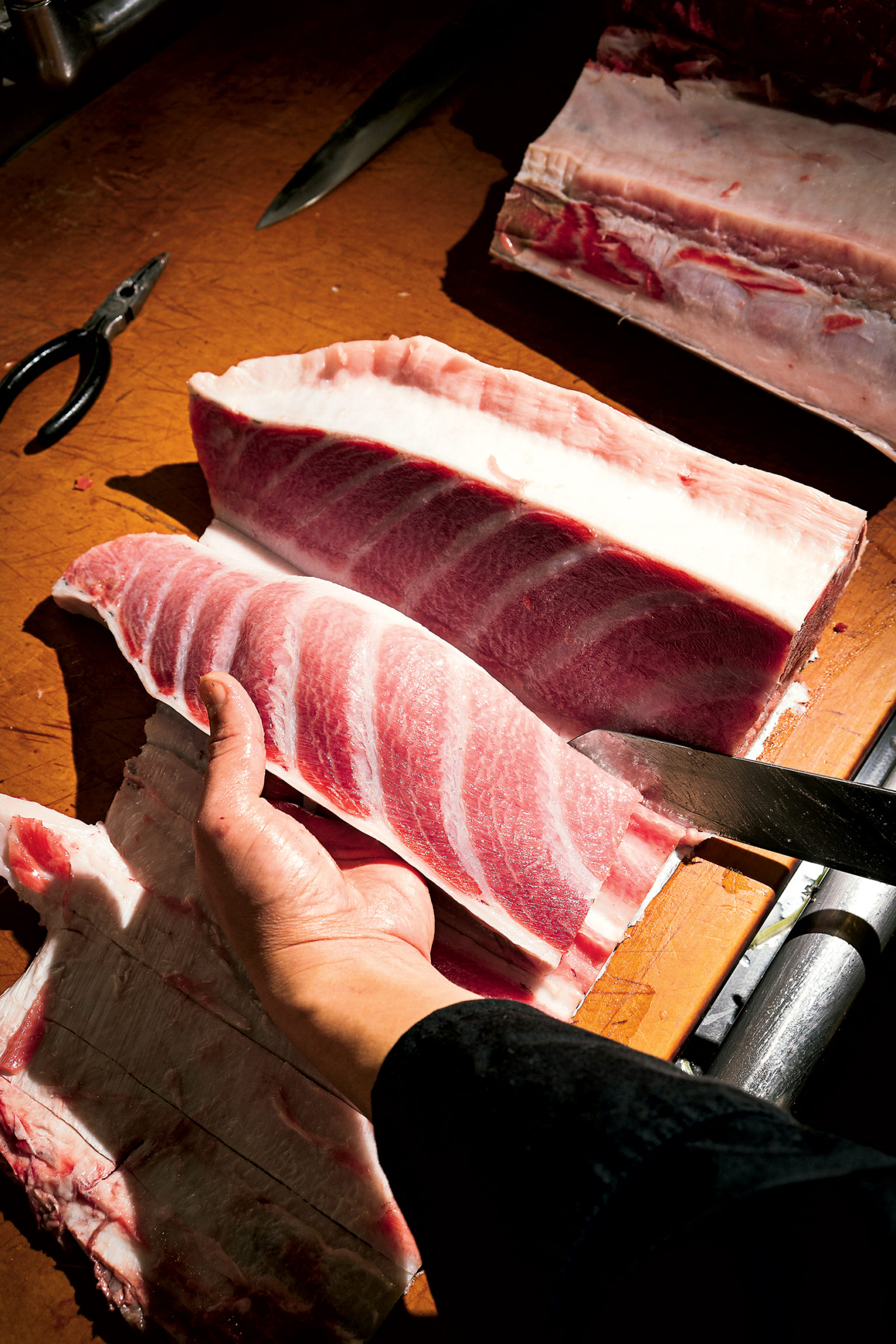 The brothers say some of the best bluefin tuna is farm-raised in Spain. And fresh isn't actually better – they dry-age the fish, like steak, for about ten days.