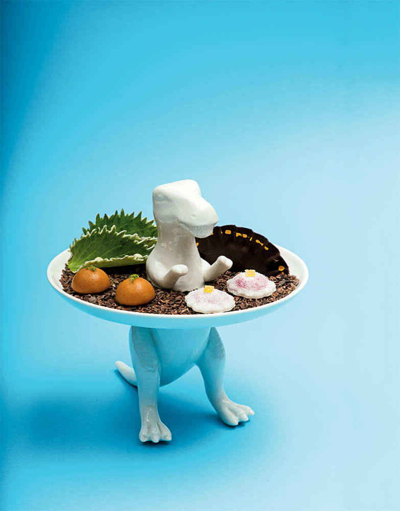 Left: Ceramic dinosaur plate for petits fours at Minibar.