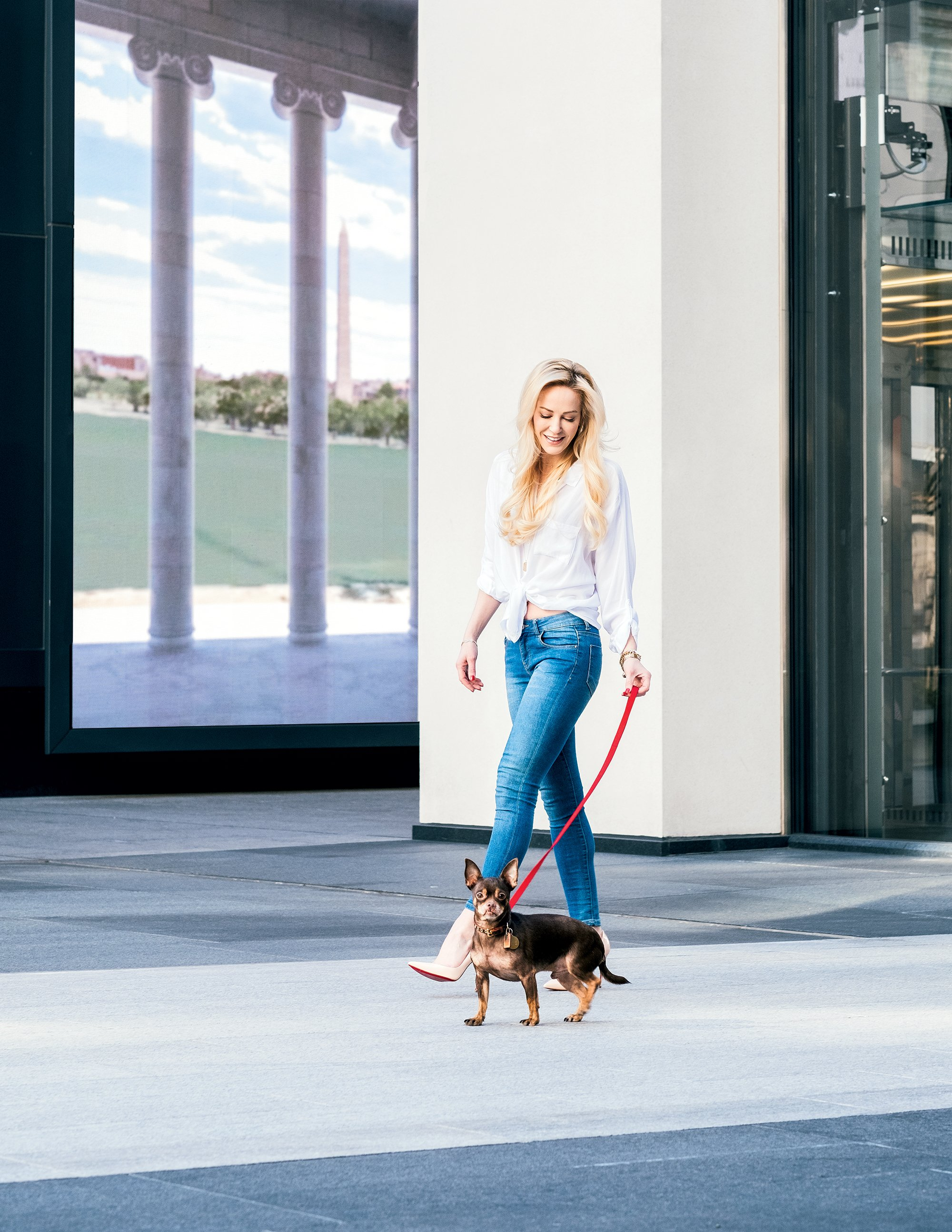 Linton walks her dog at CityCenterDC. Photograph by Marisa Guzman-Aloia.