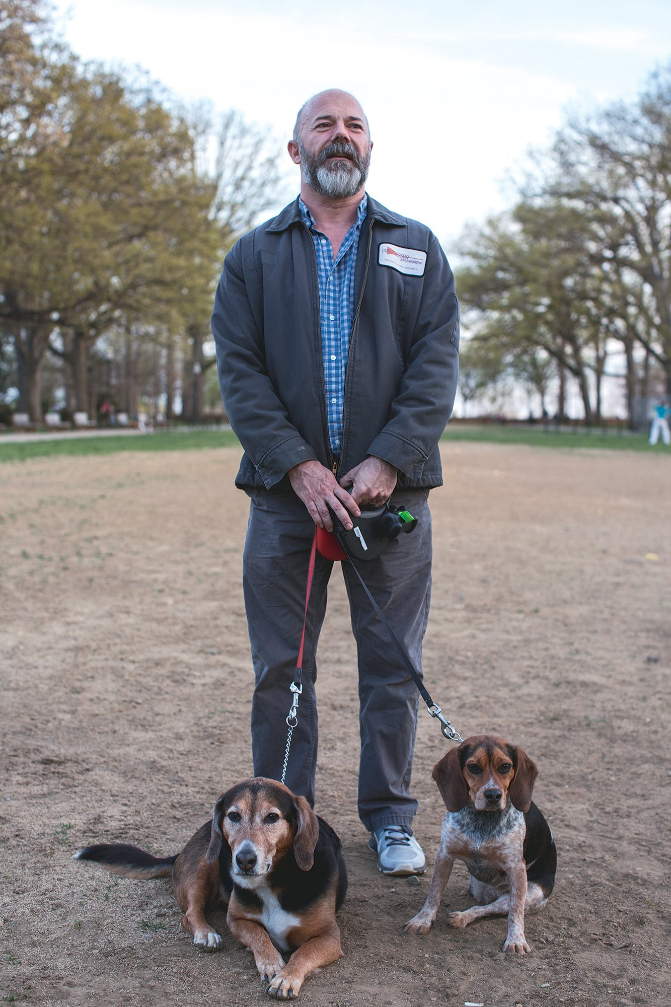 Sullivan with his dogs in Meridian Hill Park. Photograph by Joshua Cogan.