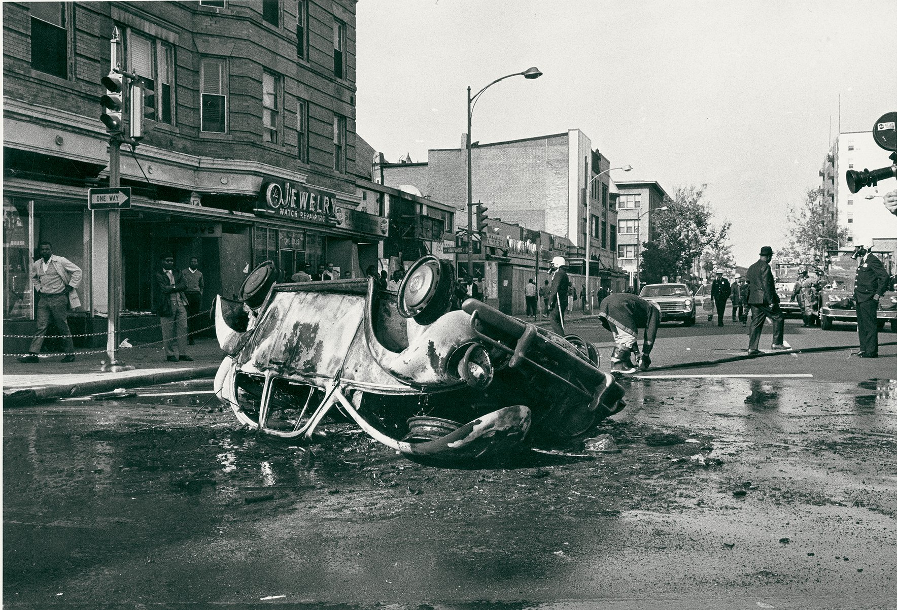 The city remained tense well after the initial destruction and chaos, with clashes still bubbling up. A car that was torched by a crowd at 14th and Harvard in November 1968. Photograph by Washington Post. Reprinted with Permission of DC Public Library/Star Collection.