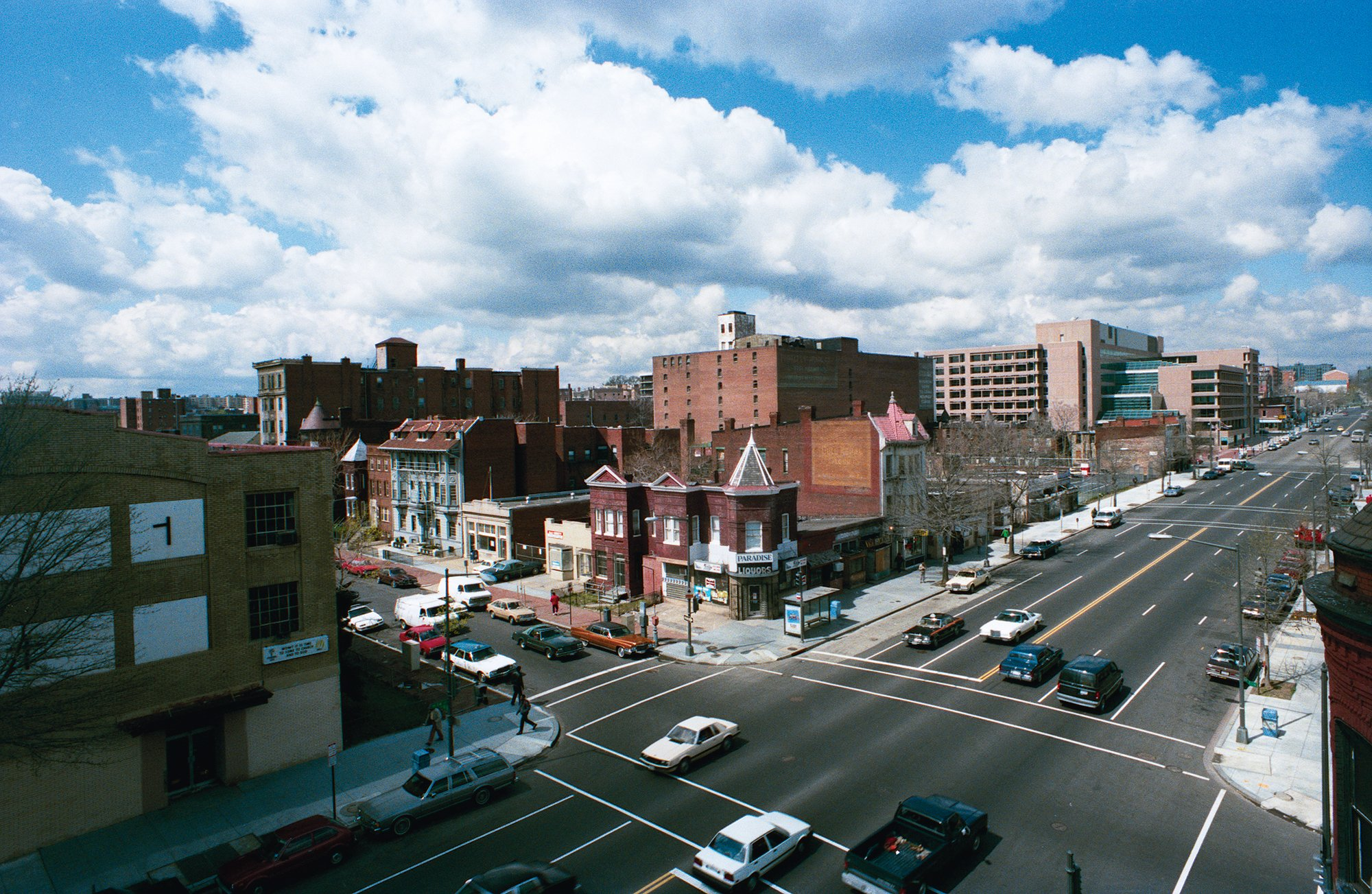 In the 1980s, while most of the street was still empty, open-air drug markets flourished at 14th and T (above) as well as one block south. Photograph by Michael J. Horsley.