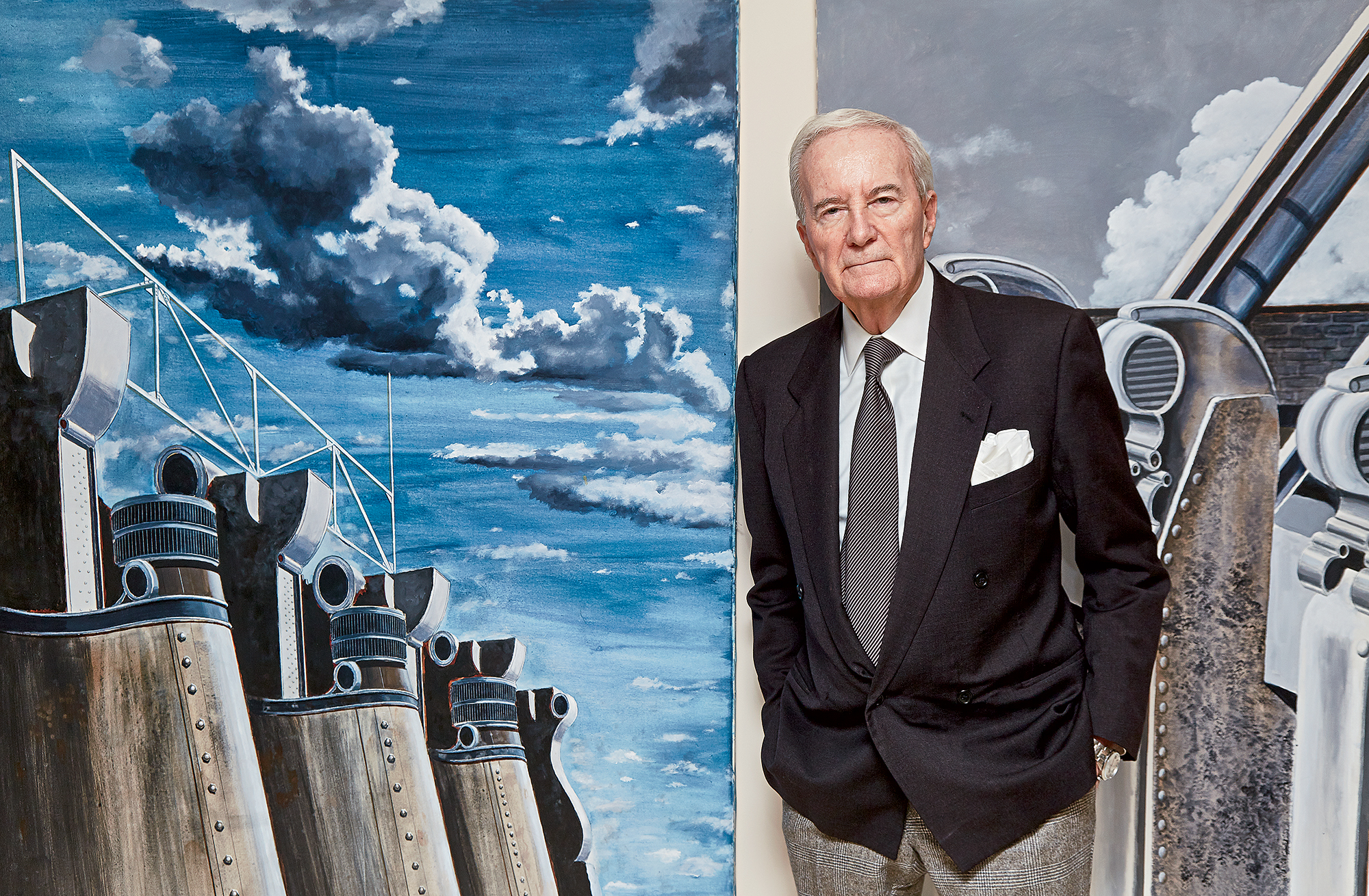 Architect Arthur Cotton Moore in front of his own paintings at his home in the Watergate. Photograph by Jeff Elkins.