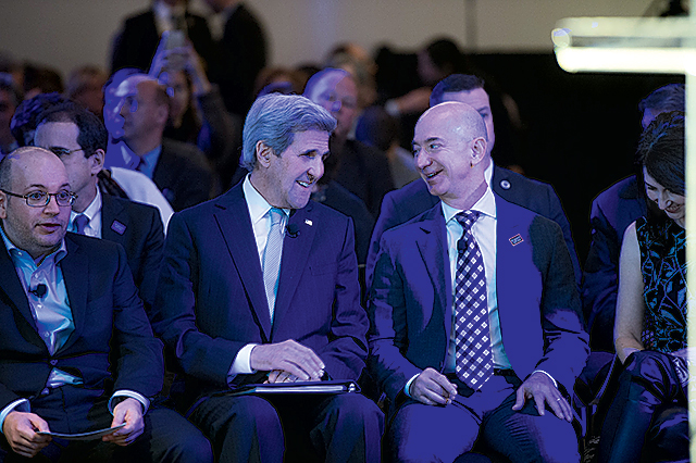 At the opening of the Post's new building with John Kerry and Post journalist Jason Rezaian, who had been in prison in Iran. Photograph by Dan Swartz.