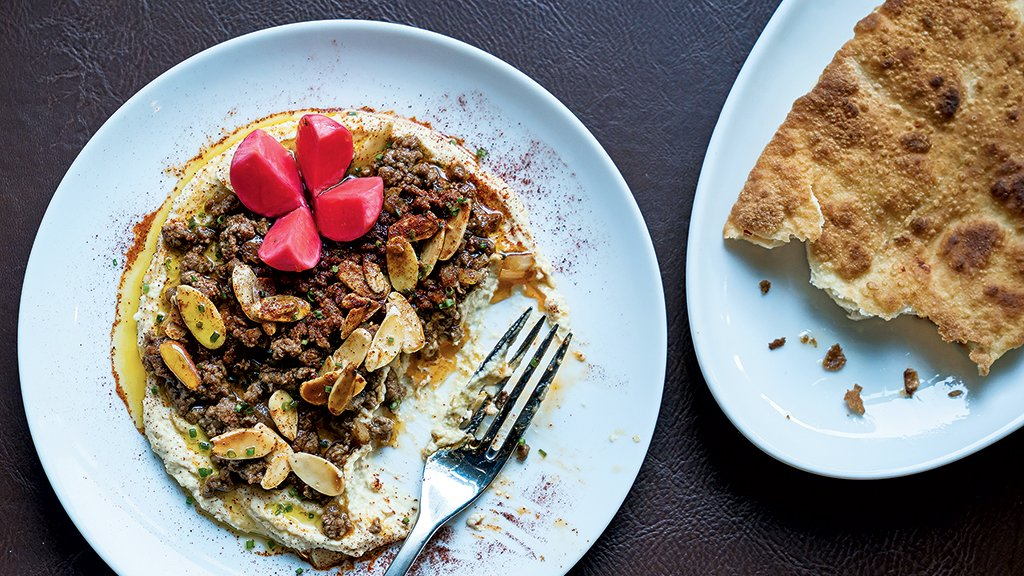 Hummus with sautéed beef and snowshoe naan at the eclectic new Chloe. Photograph by Scott Suchman.