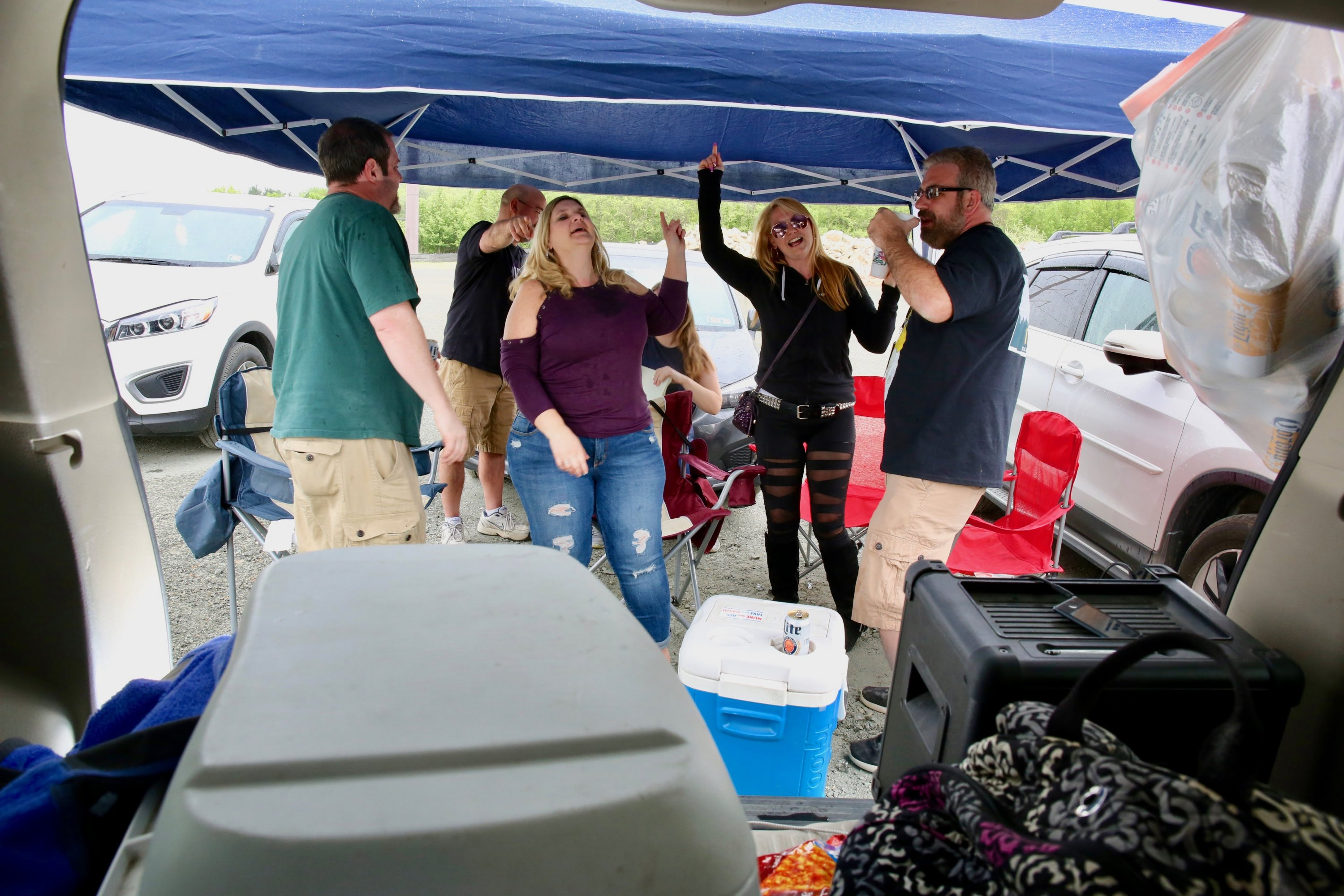 Rick, Michelle, Colleen, and Jeff pump themselves up before the show.