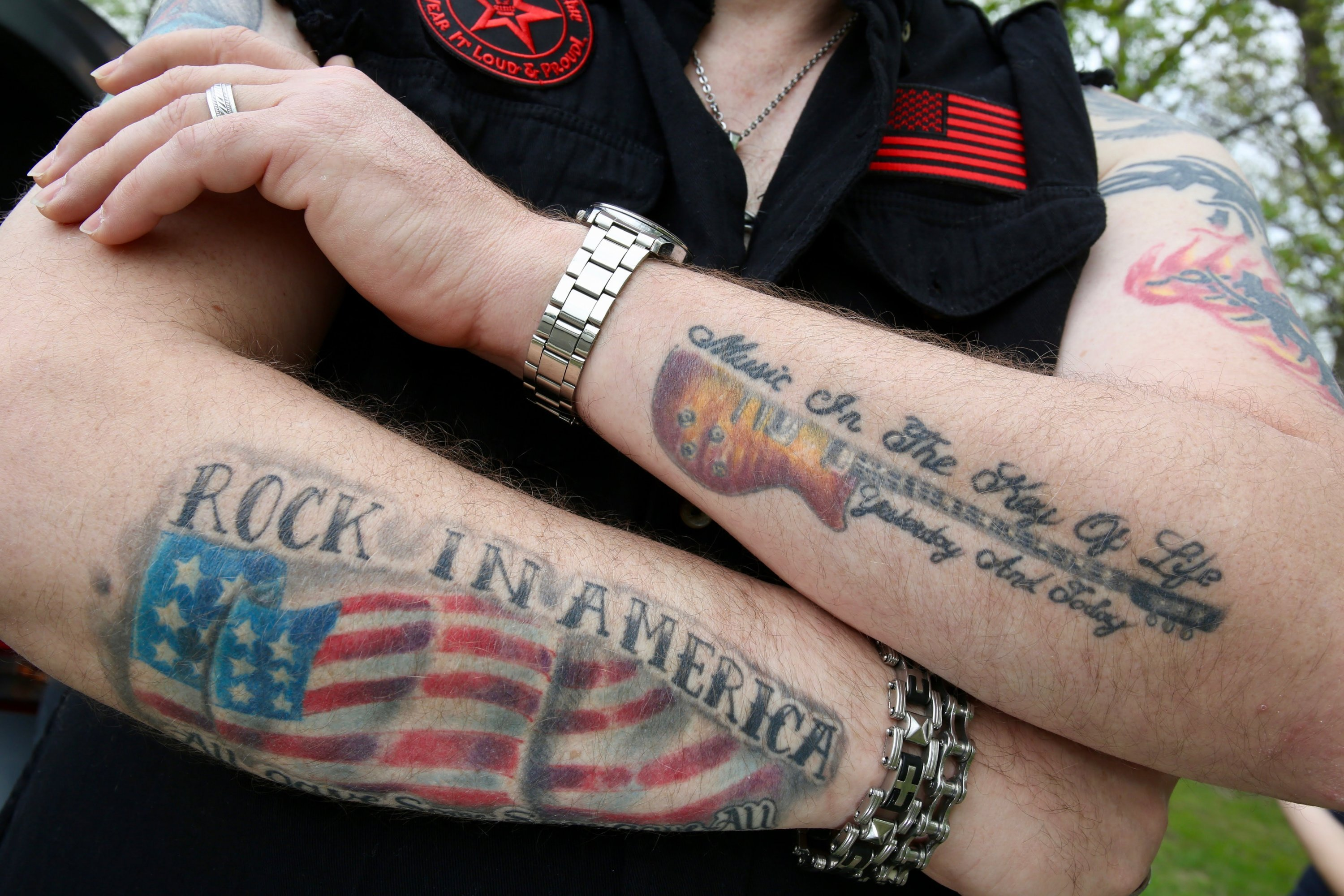 Garry has a lot of tattoos that show off the various metal concerts he's attended.
