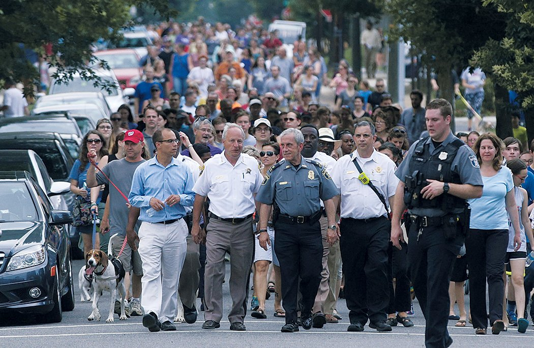 Alexandria residents staged an impromptu solidarity walk to a local church. Photograph of by Tom Williams/CQ Roll Call.