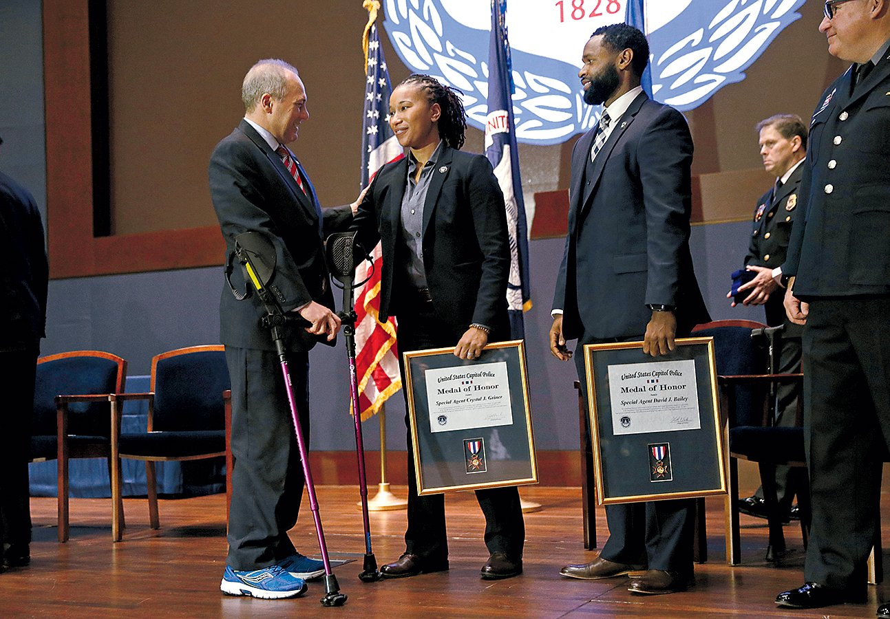 Scalise at a ceremony with Crystal Griner and David Bailey, the agents who saved his life. Photograph Reuters/Kevin Lamarque.