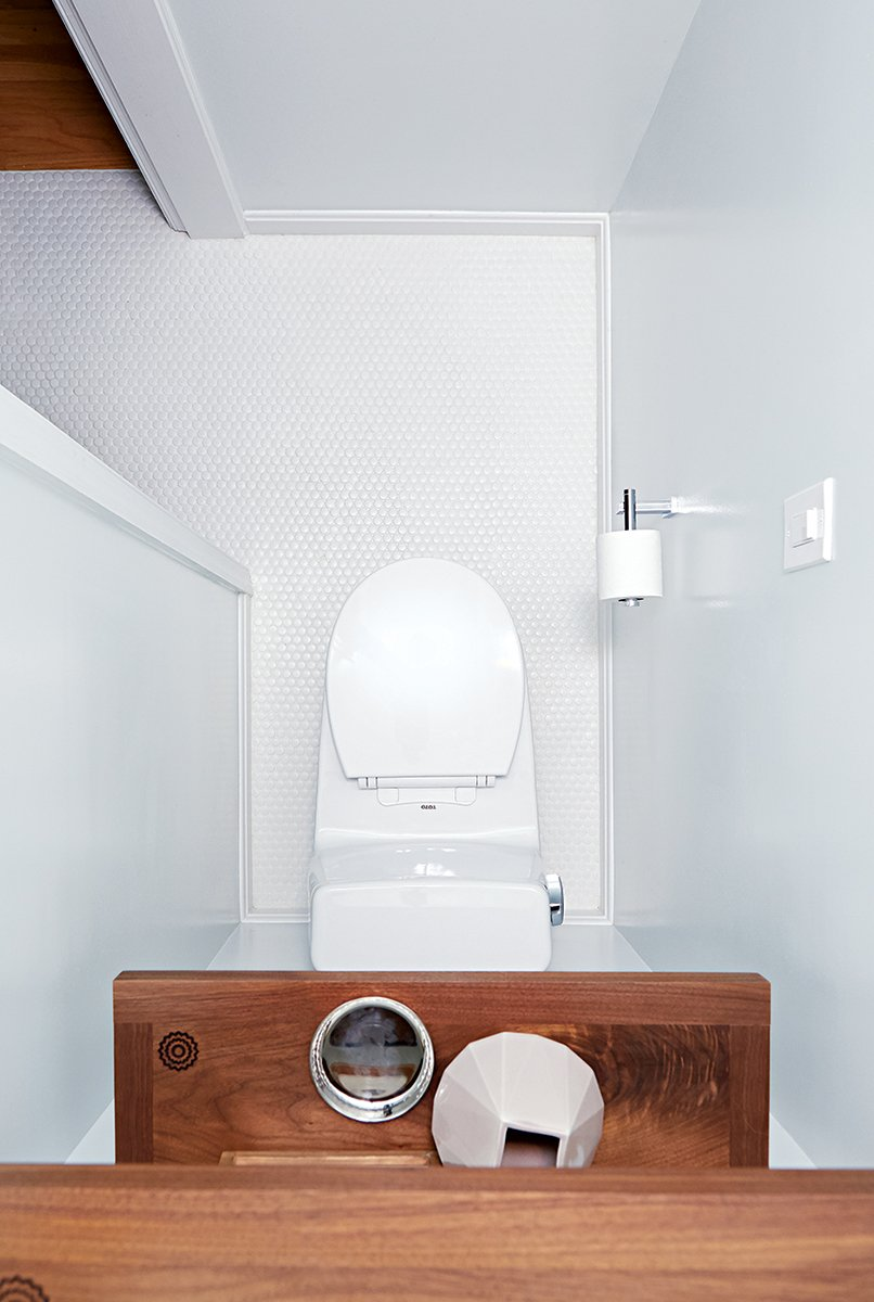 A bedroom closet became space for the toilet. Photograph by Jeff Elkins.