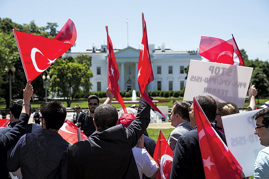 Supporters of Turkish leader Recep Tayyip Erdogan demonstrate outside the White House on May 16, 2017. Photograph by Samuel Corum/Anadolu Agency/Getty Images.