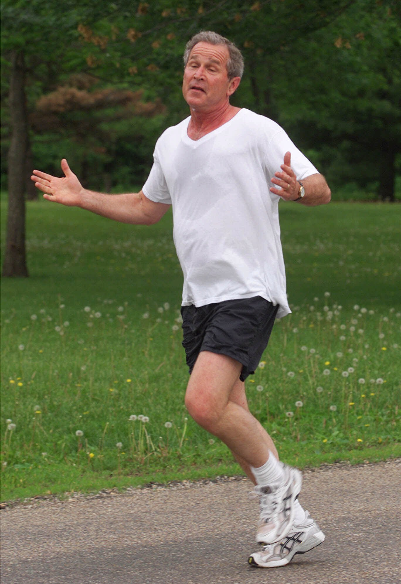 President Bush jogs in Water Works Park in Des Moines, Iowa, in 2001. Photograph by AP Photo/Ron Edmonds.