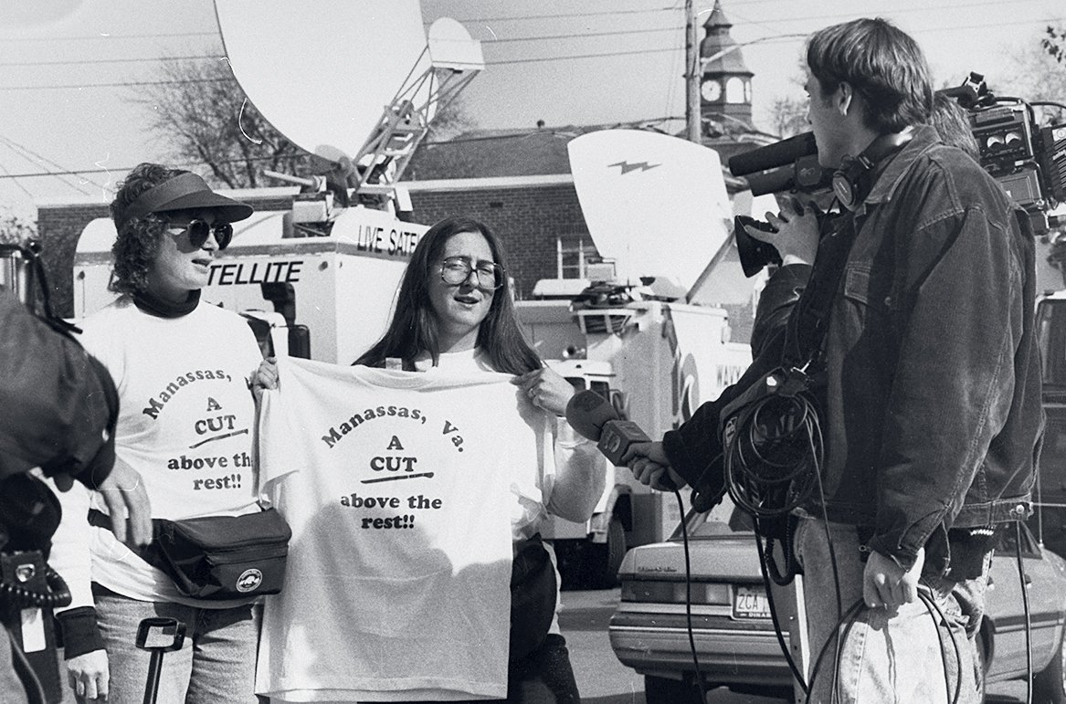 Arlene Banton (left) and Windy Shepley being filmed by media while hawking t-shirts. Photograph by Robert Sherbow/ LIFE Images Collection/Getty Images.