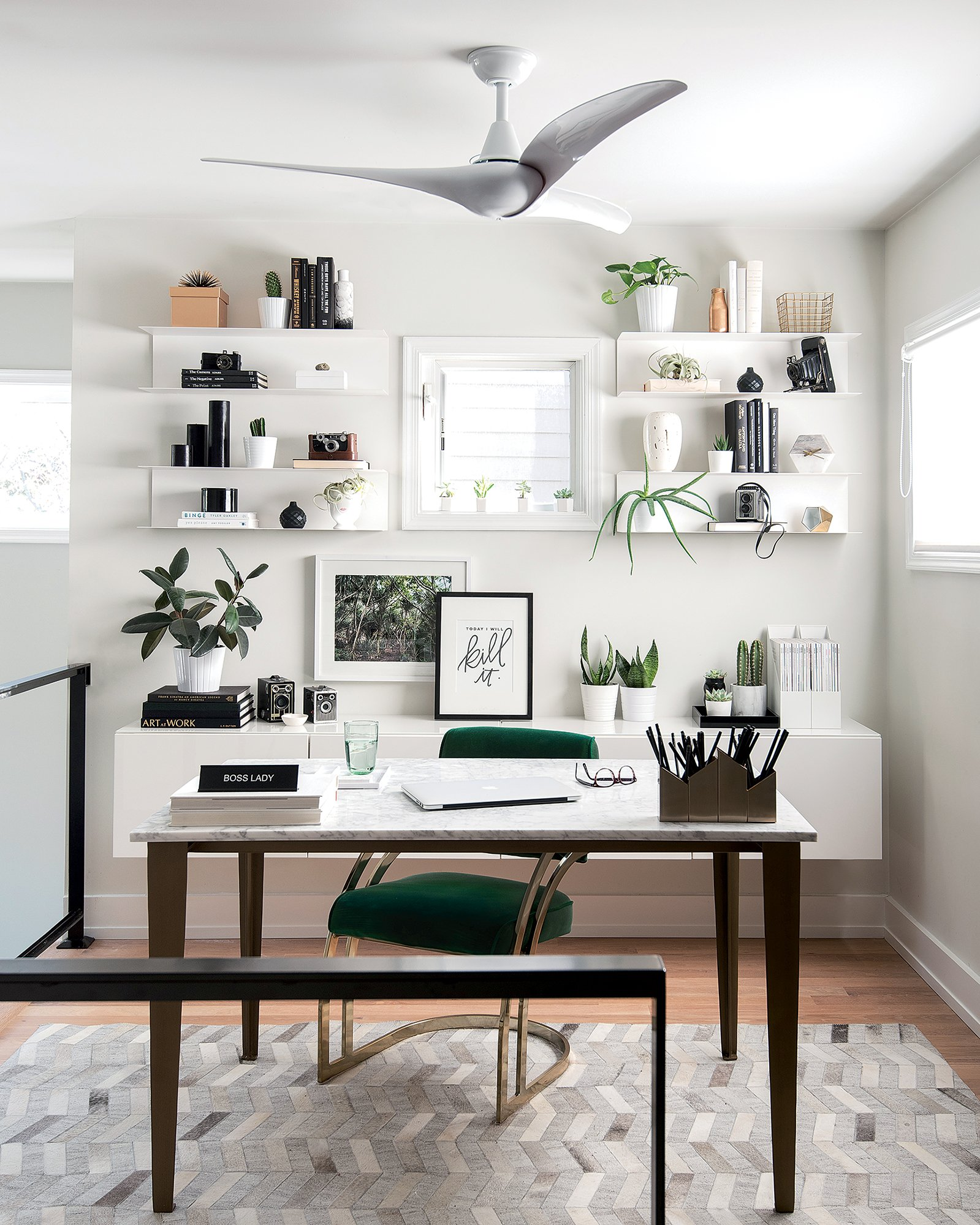 Laura Metzler's desk, top, is actually a dining table from CB2. She says it's one of the few items she was willing to pay full price for, because she often works from home.