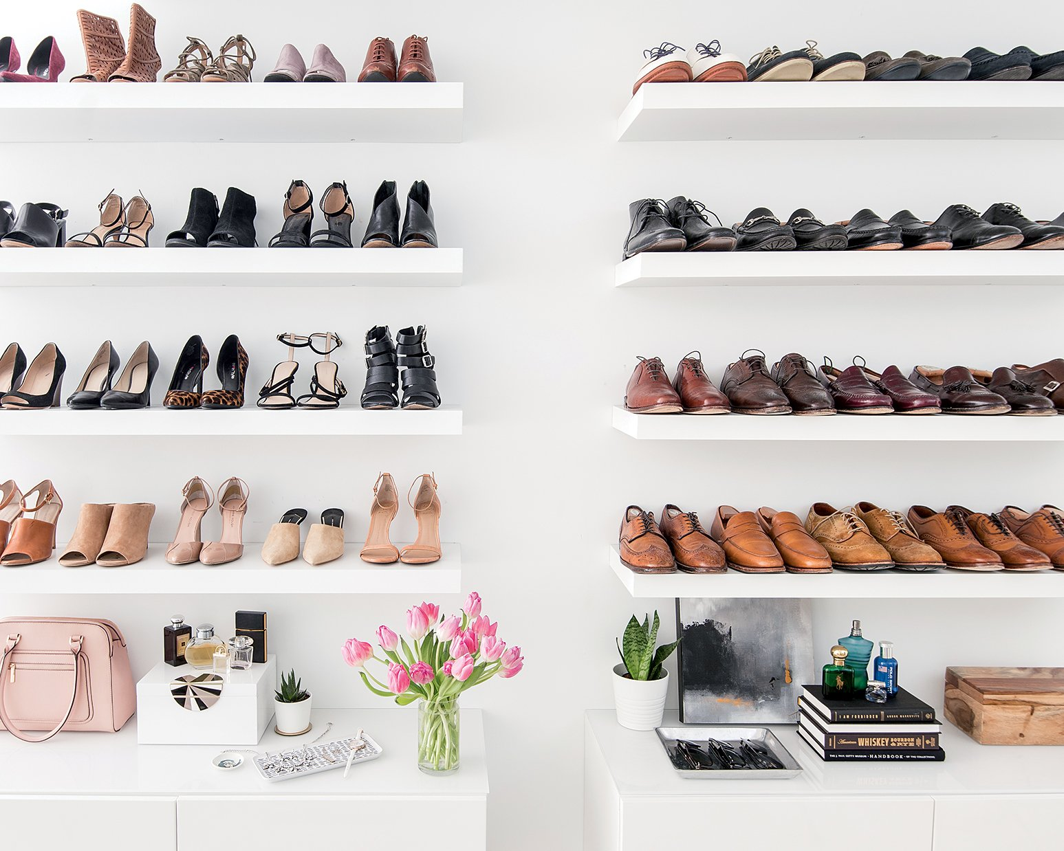 In the entry to the master bedroom, Metzler installed a wall of Ikea shelving to hold shoes.
