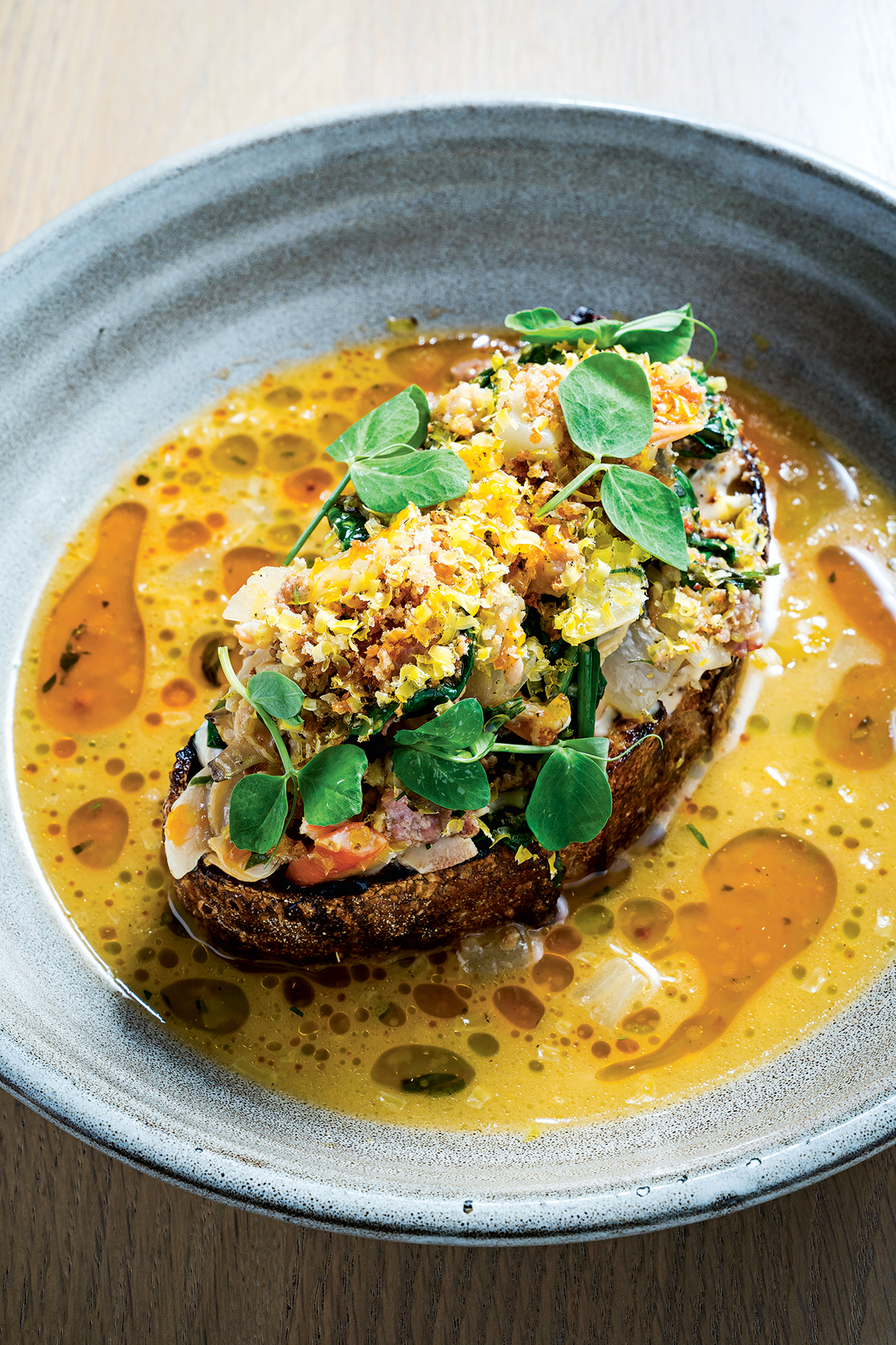 Creamy, briny clam toast. Photograph by Scott Suchman.