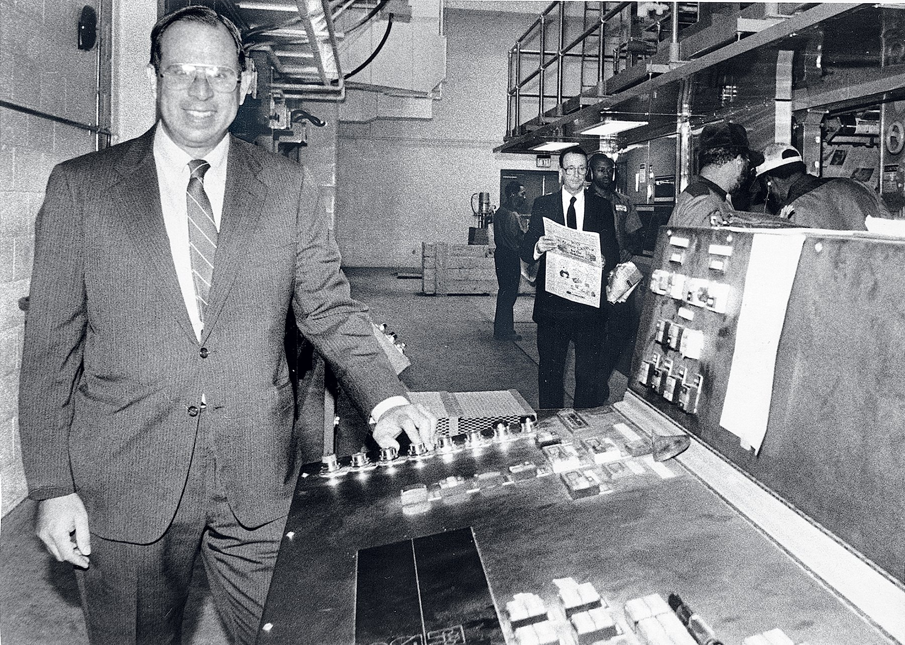 The author's father, Phil Merrill, starts the presses in the 1980s. Photograph courtesy of Catherine Merrill Williams.