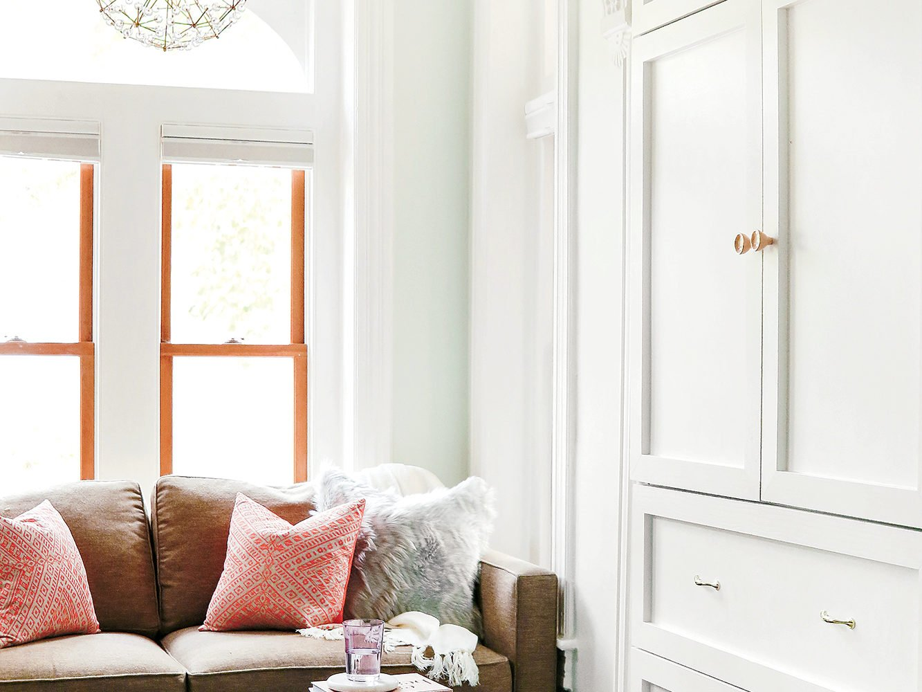 Mary Jo Major did away with the clutter that littered the old space by adding built-in storage to the window alcove.