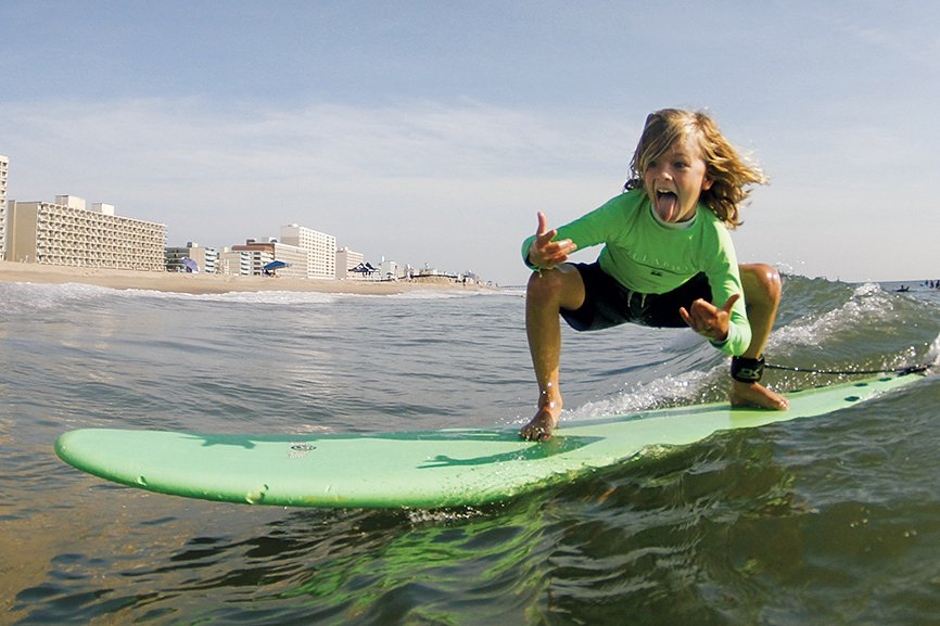 Photograph of surfer courtesy of 17th Street Billabong Surf Camp.