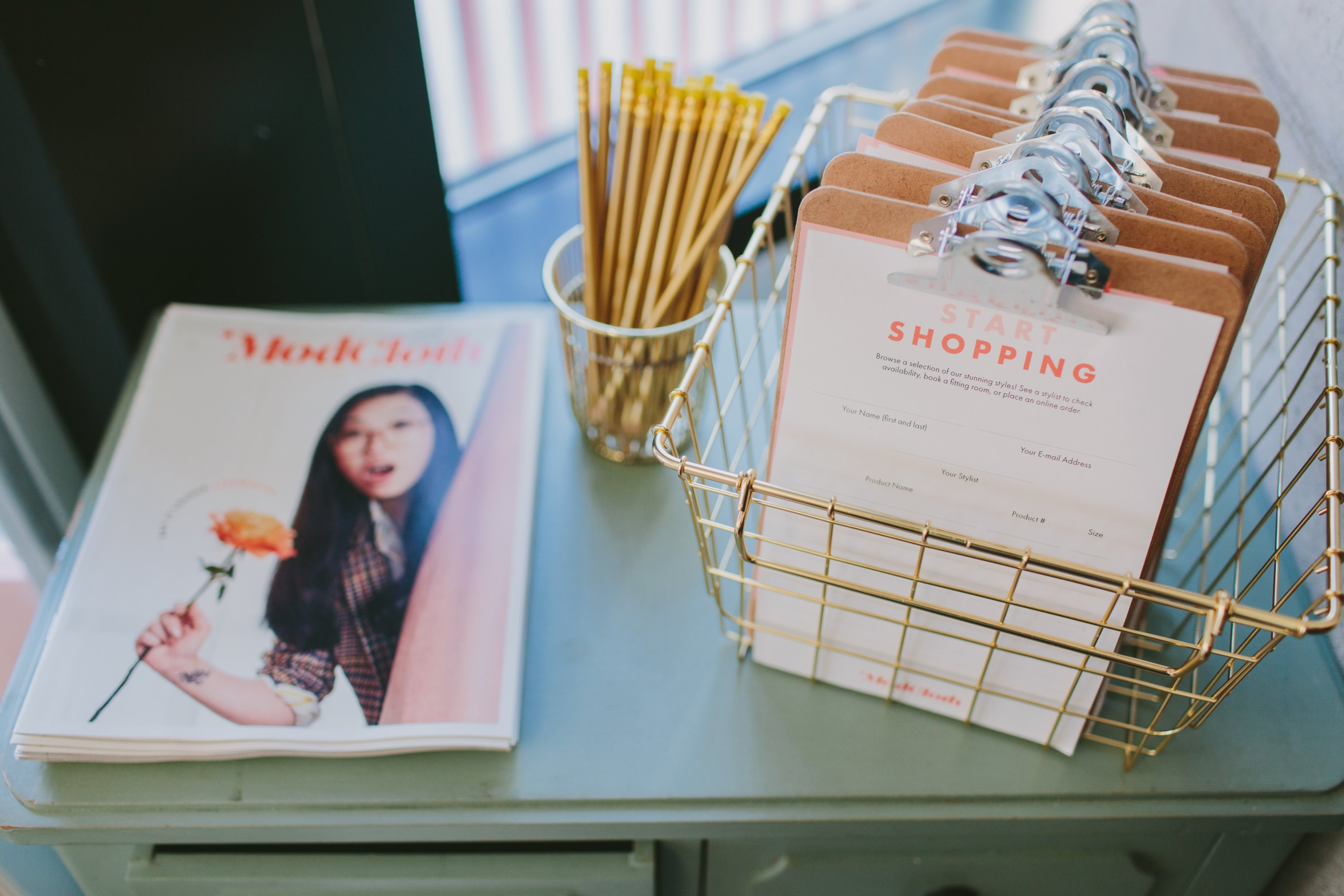 Shoppers will compile lists of clothes to try on and order using these clipboards. Photograph by Tori Watson Photography, courtesy of ModCloth.