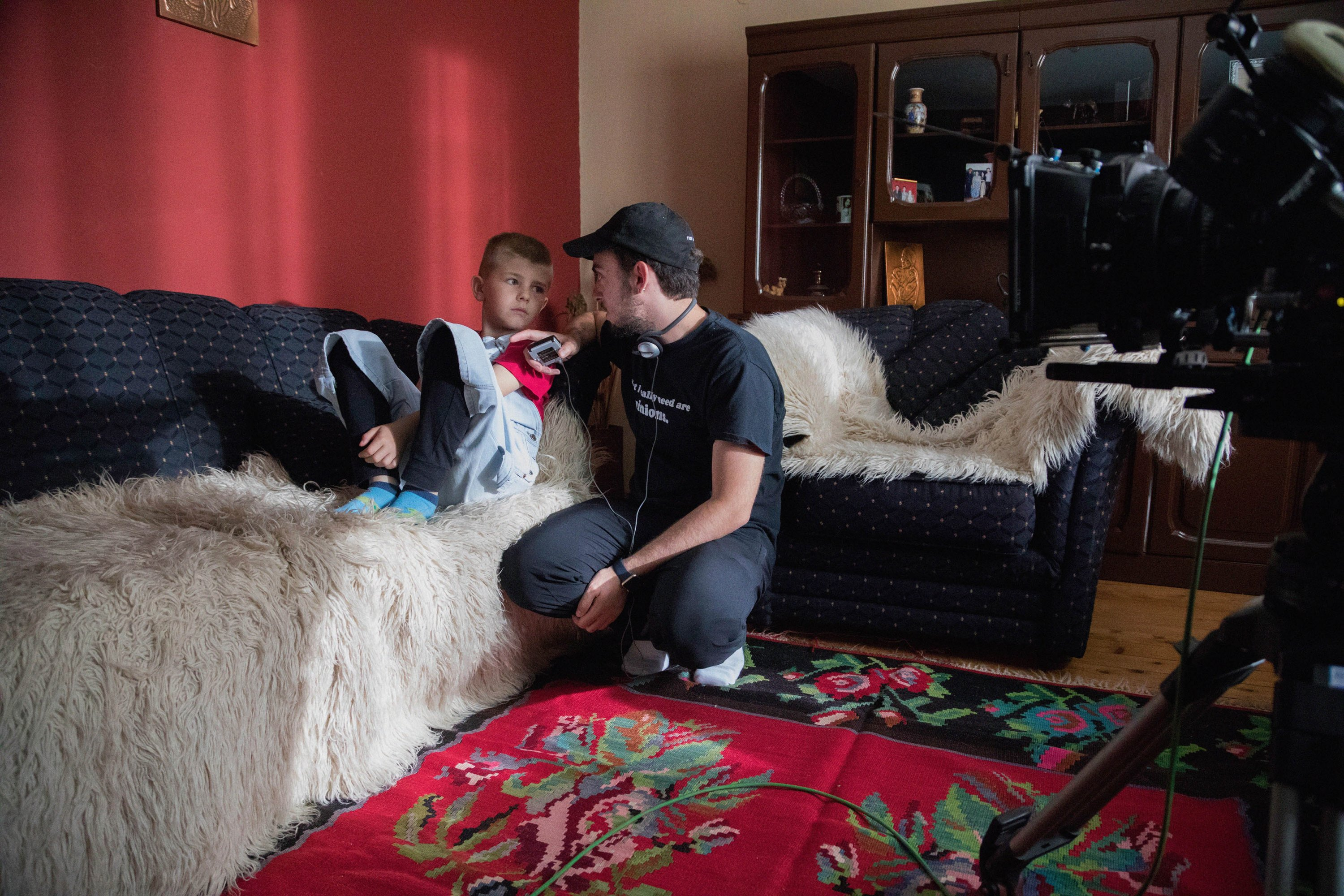 Behind the scenes, Erblin Nushi chats with the young actor who plays Nushi in the film. Photograph courtesy of Tilia Entertainment.