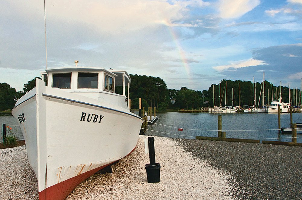 Northern Neck, Virginia Oysters. The retired deadrise workboat Ruby decorates Merroir's waterfront promenade.