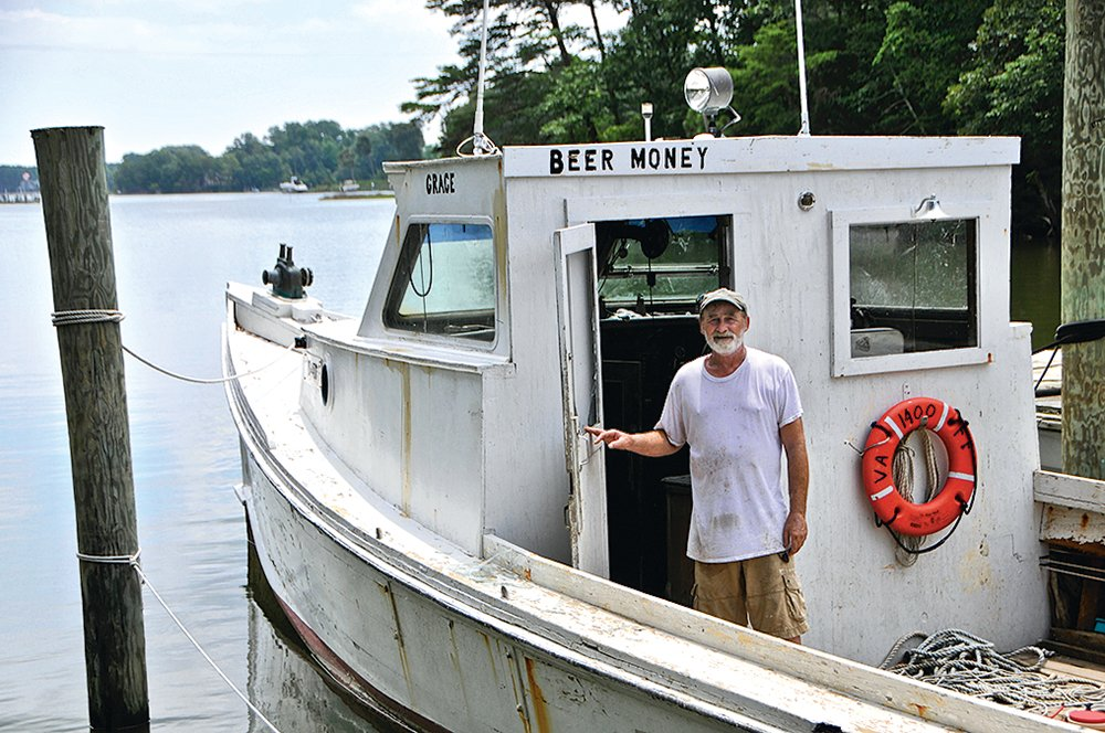 Northern Neck, Virginia Oysters. Coates aboard his curiously named workboat.