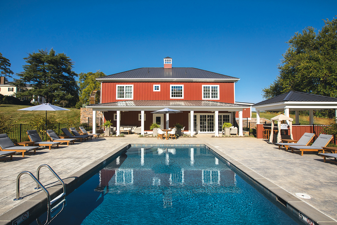 The Inn at Willow Grove's new spa, which resembles a red barn, has a heated saltwater pool. Photograph of pool by Aaron Watson Photography.