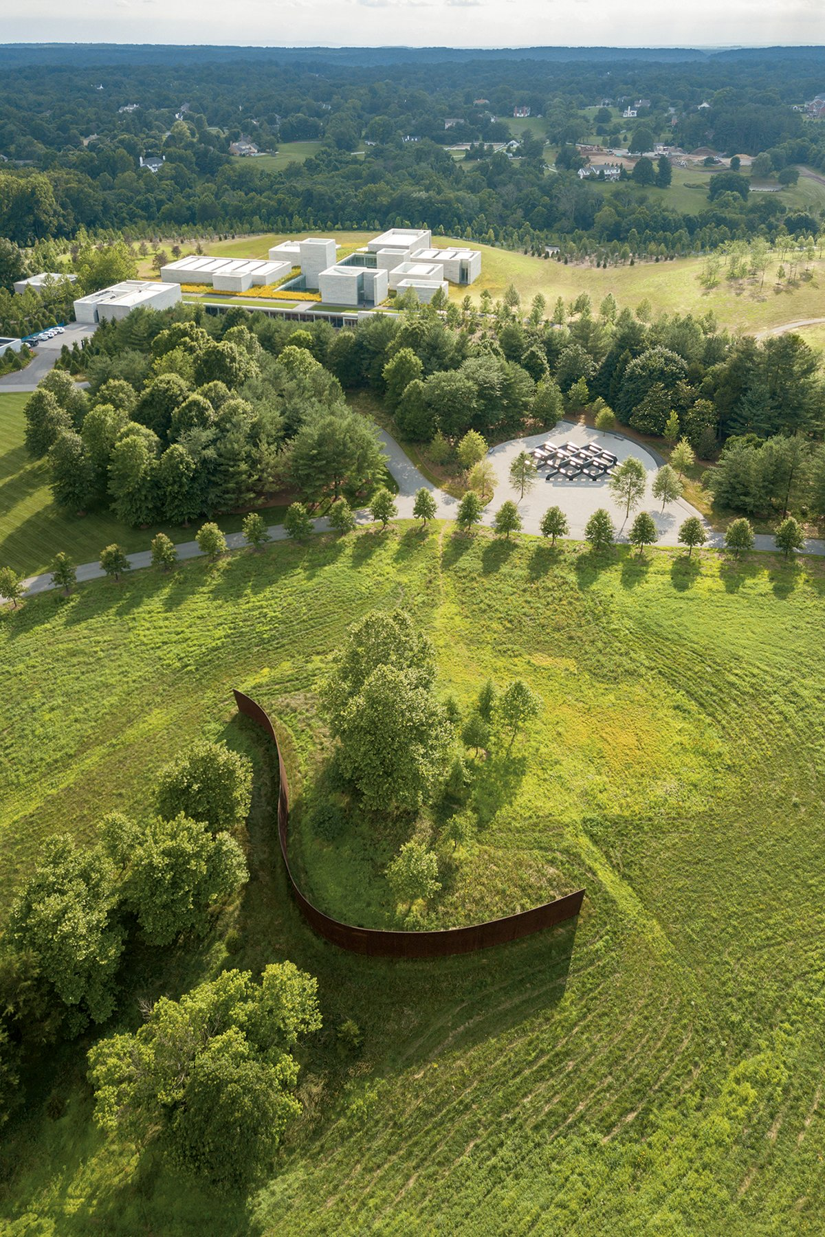 Surrounded by a lush landscape, Glenstone's new building is mostly underground. Photograph by Iwan Baan.