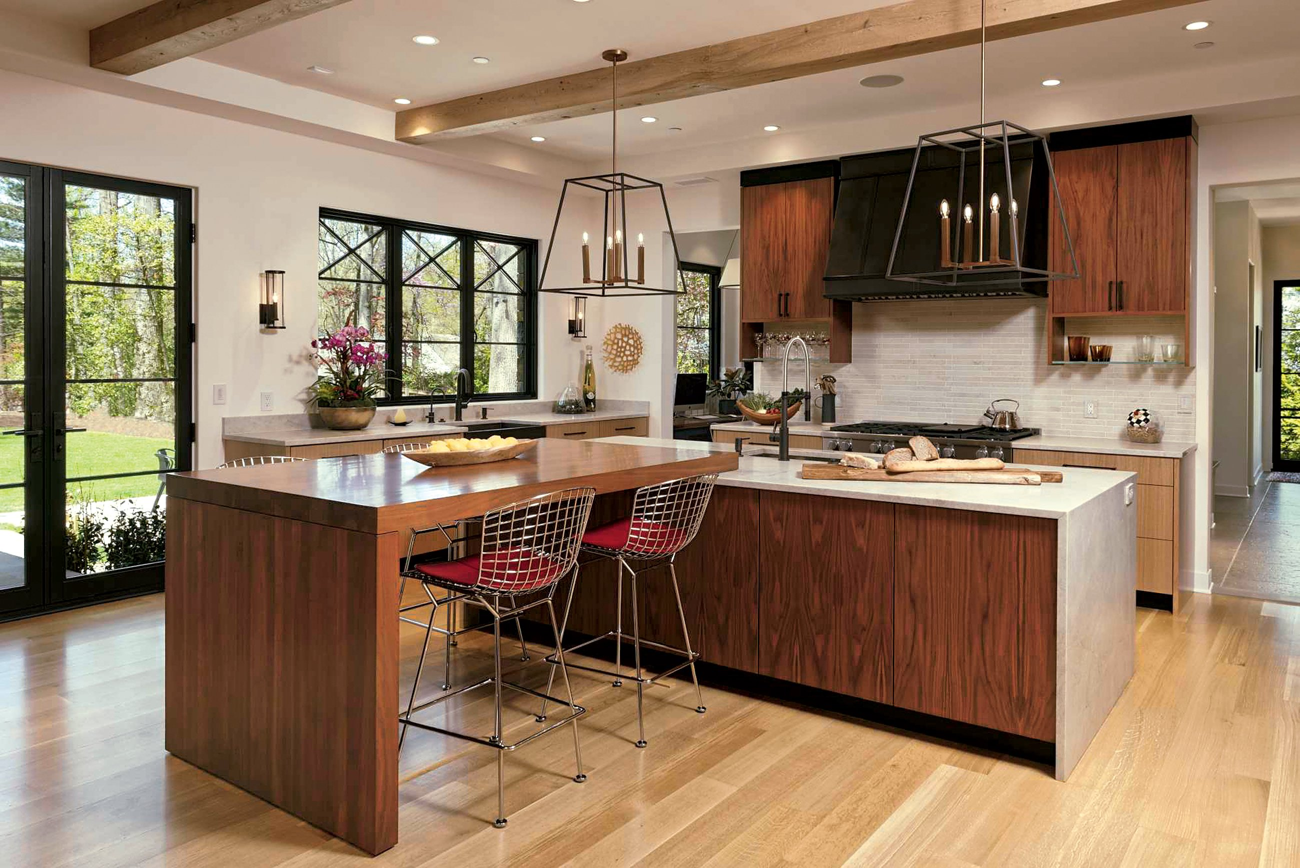 Quartzite countertops in a leather finish add rugged texture. The walnut and oak cabinetry is by Heartwood Design in Afton, Virginia. Photograph by Bob Narod/GTM Architects.