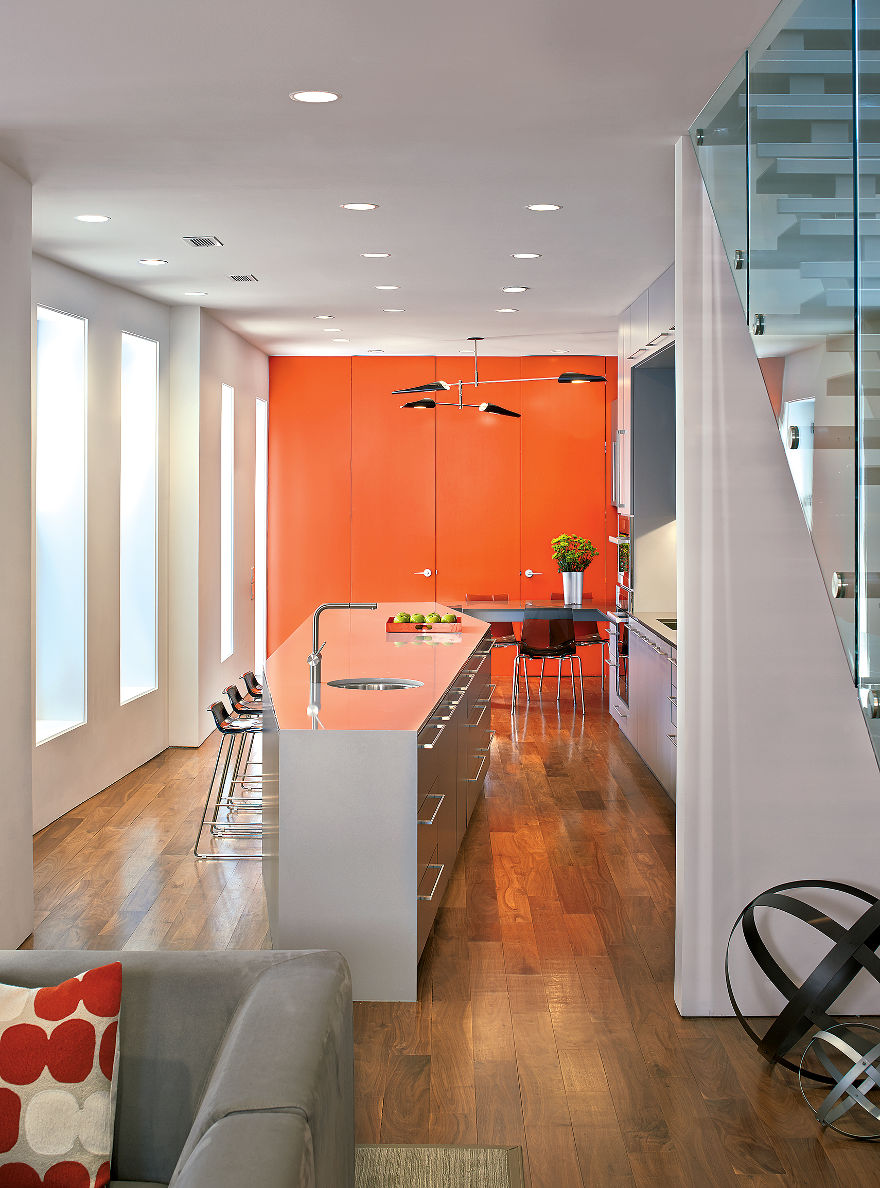 The bright back wall in this West End rowhouse designed by architect Robert Gurney includes doors to a storage-packed pantry and a powder room. Photograph by Anice Hoachlander.