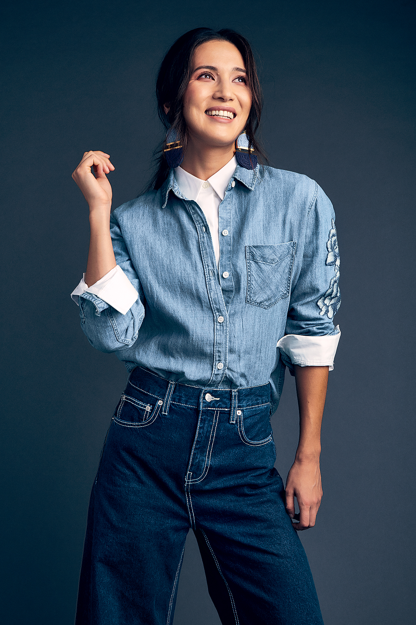 White shirt, $50 at the Gap; Rails blue denim shirt, $168 at Saks; jeans, $50 at Zara; pendant earrings, $185 at makua.co.