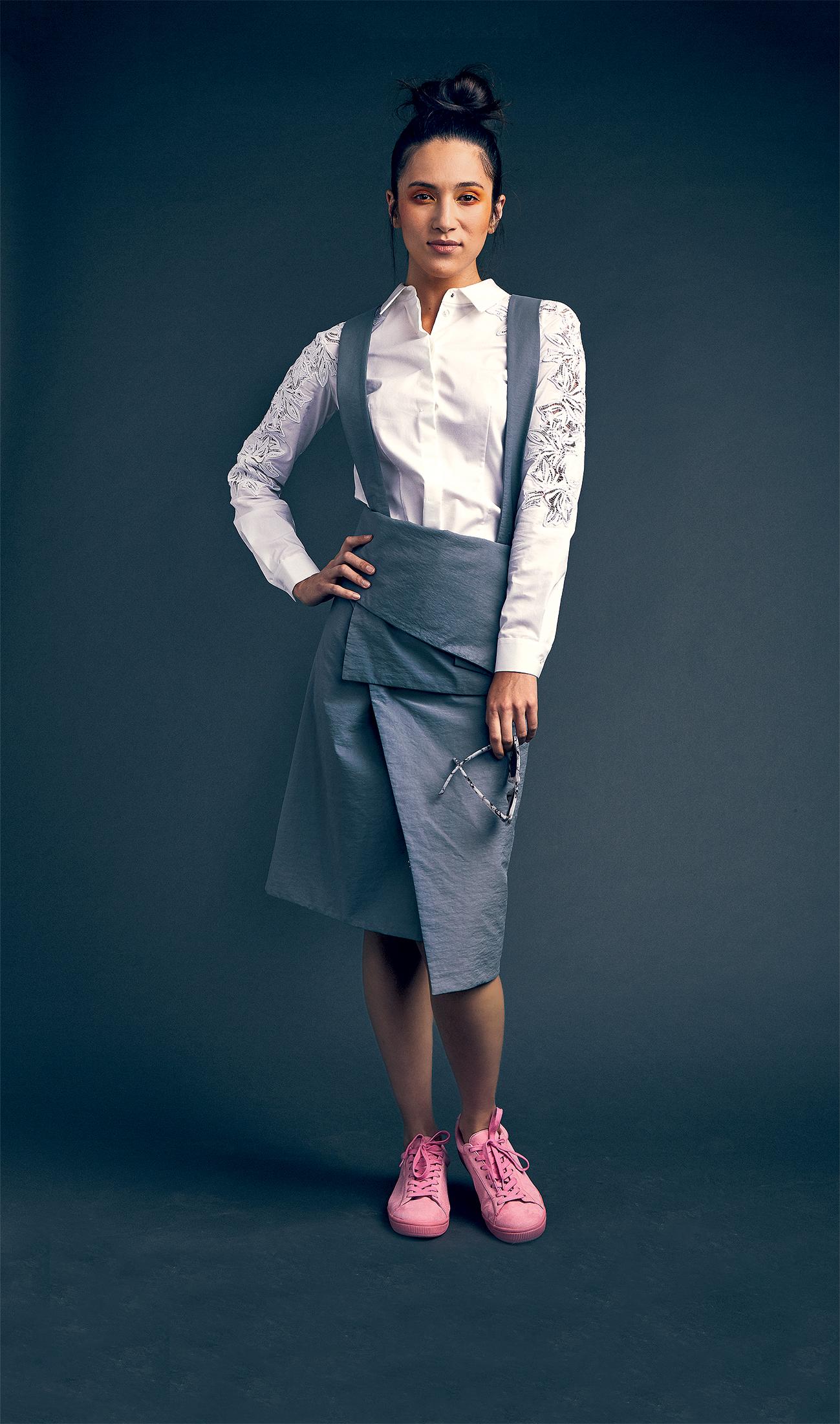 Elie Tahari white blouse, $161 at Saks; gray dungaree dress, $175 at Cos; pink sneakers, $150 at Puma.