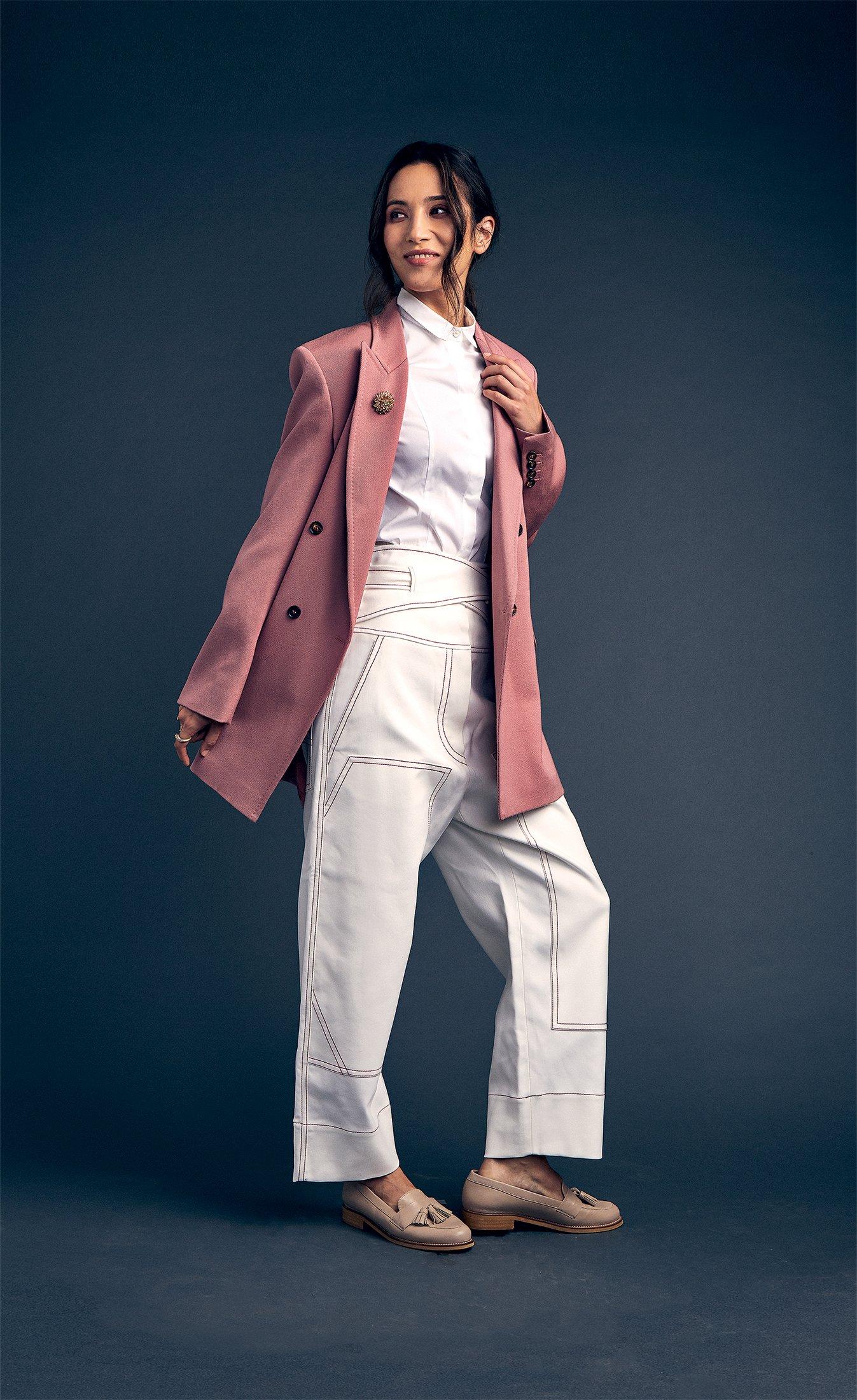 Peserico white shirt, $415 at Saks; pink coat, $3,890, and white pants, $695, both at Max Mara; New Look tassel loafers, $37 at asos.com.