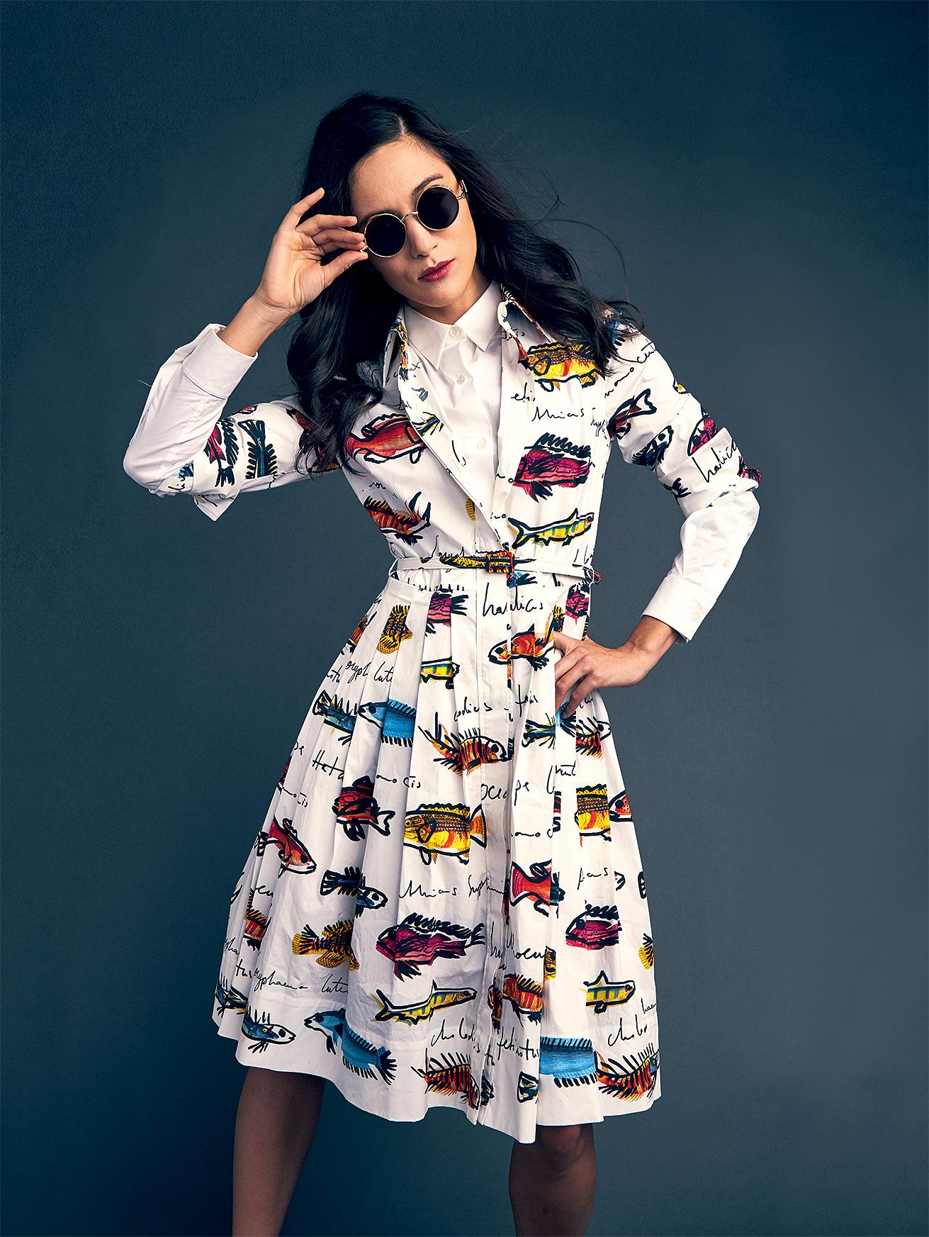 White shirt, $140 at Club Monaco; Oscar de la Renta fish-print dress, $2,190 at Saks; Le Spec sunglasses, $59 at Urban Outfitters.
