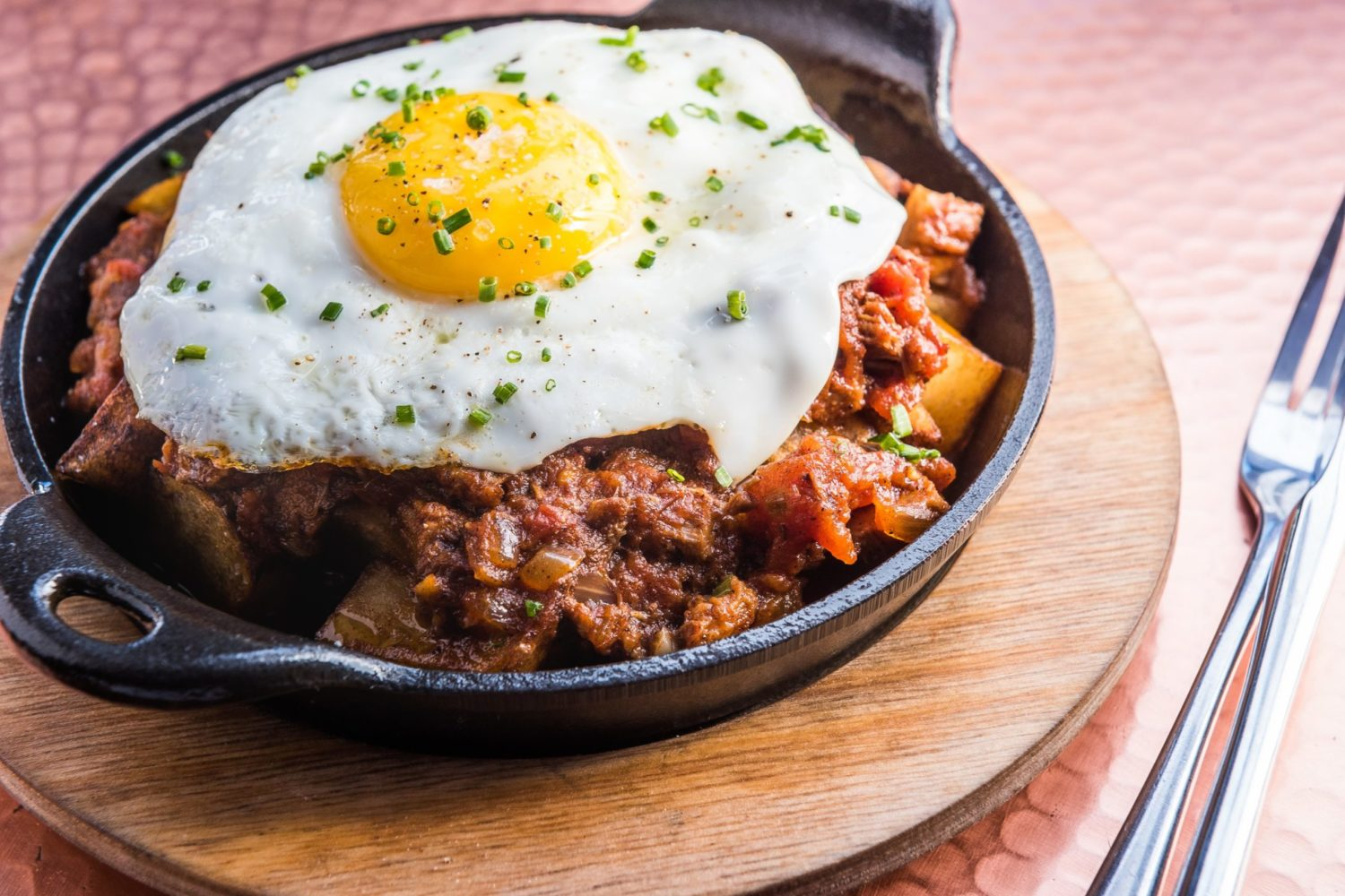 Brisket Chili Hash at America Eats Tavern. Photograph by Rey Lopez.