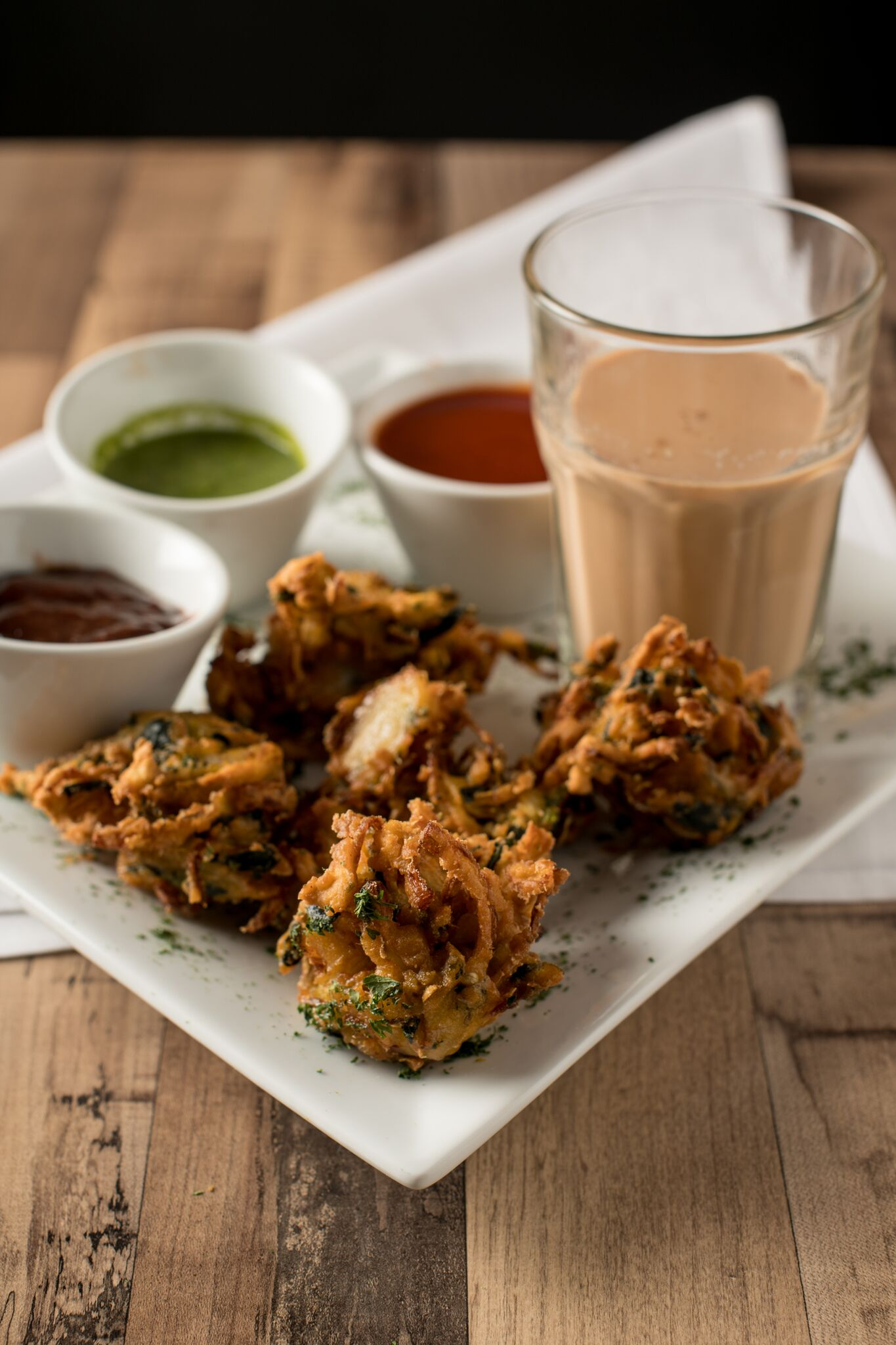 Pakora with chai from the monsoon section of the menu. Photograph by Emma McAlary.