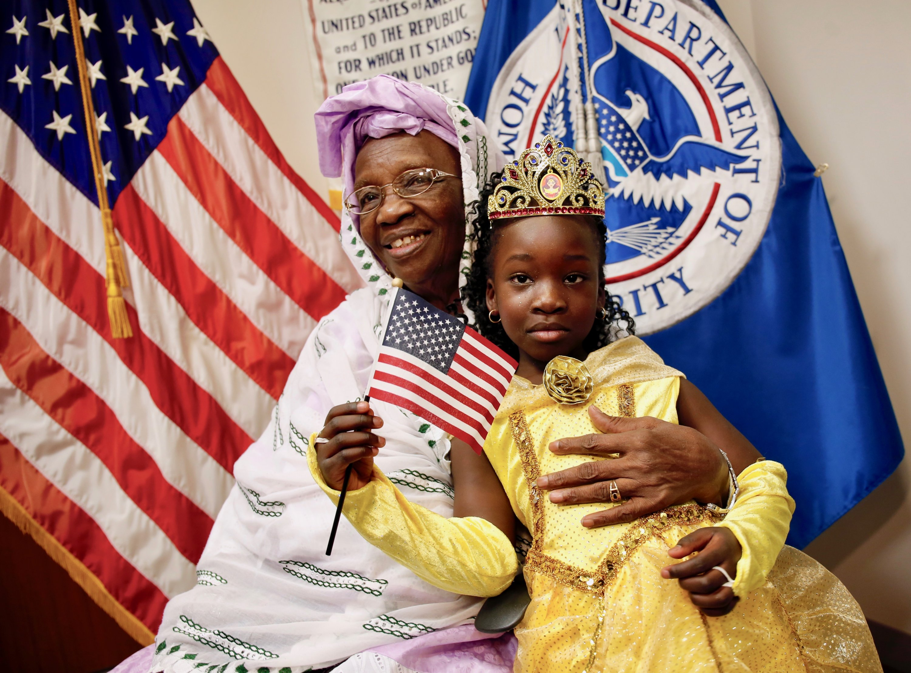 Photographs of Immigrants Becoming U.S. Citizens: A woman from Ethiopia poses with her granddaughter after she participated in a special Halloween-themed citizenship ceremony at the USCIS field office in Fairfax.