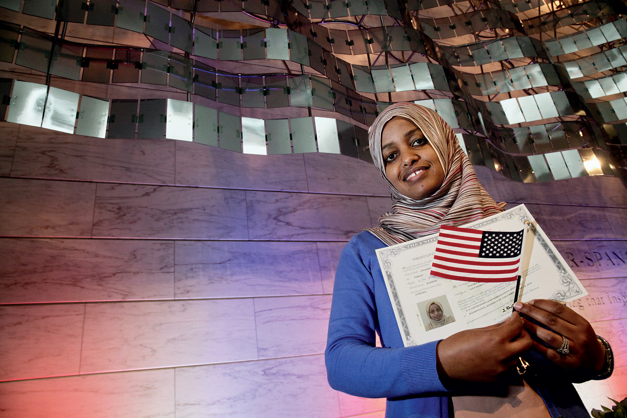 Photographs of Immigrants Becoming U.S. Citizens: National Museum of American History, June 14, 2018. The Flag Day ceremony took place in the building that houses the original Star-Spangled Banner that inspired Francis Scott Key.