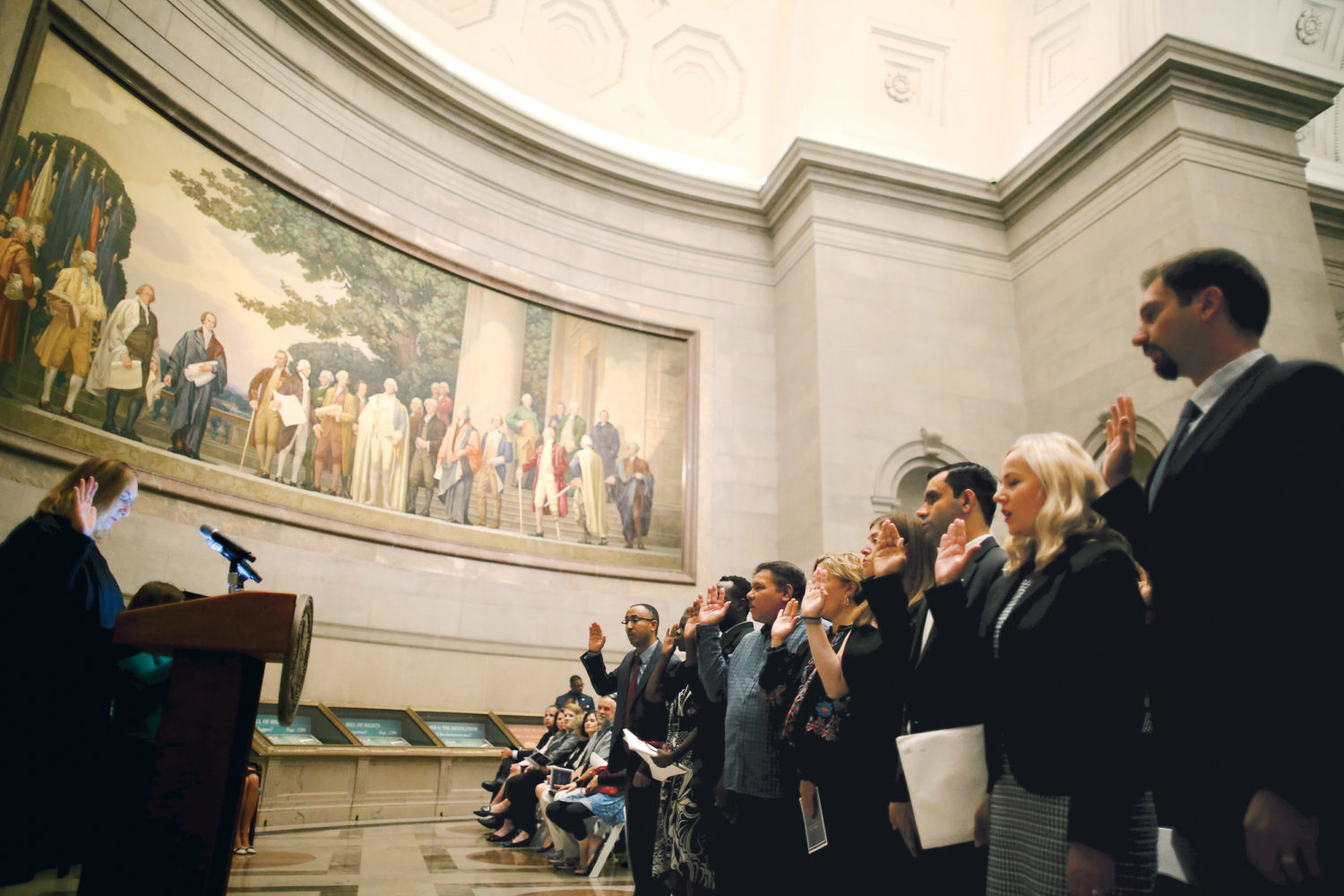 These Photographs of Immigrants Becoming U.S. Citizens in the Age of Trump Will Move You: National Archives Museum, September 15, 2017. The oath was given in the rotunda in front of the Constitution and the Declaration of Independence.