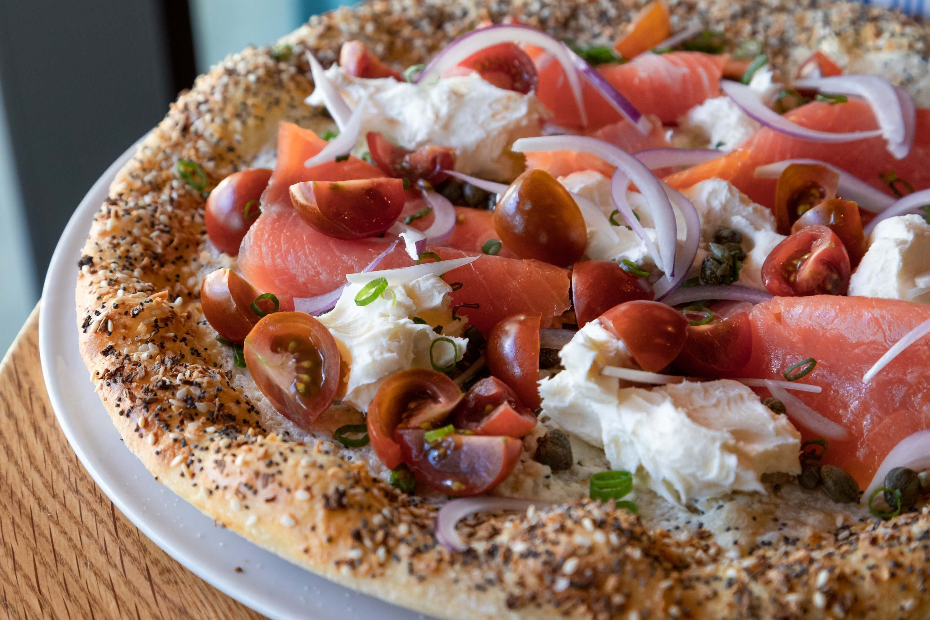 Special seasoning and smoked salmon are the toppings of choice on Alta Strada Mosaic's everything bagel pizza. Photograph courtesy by Clark Douglas.