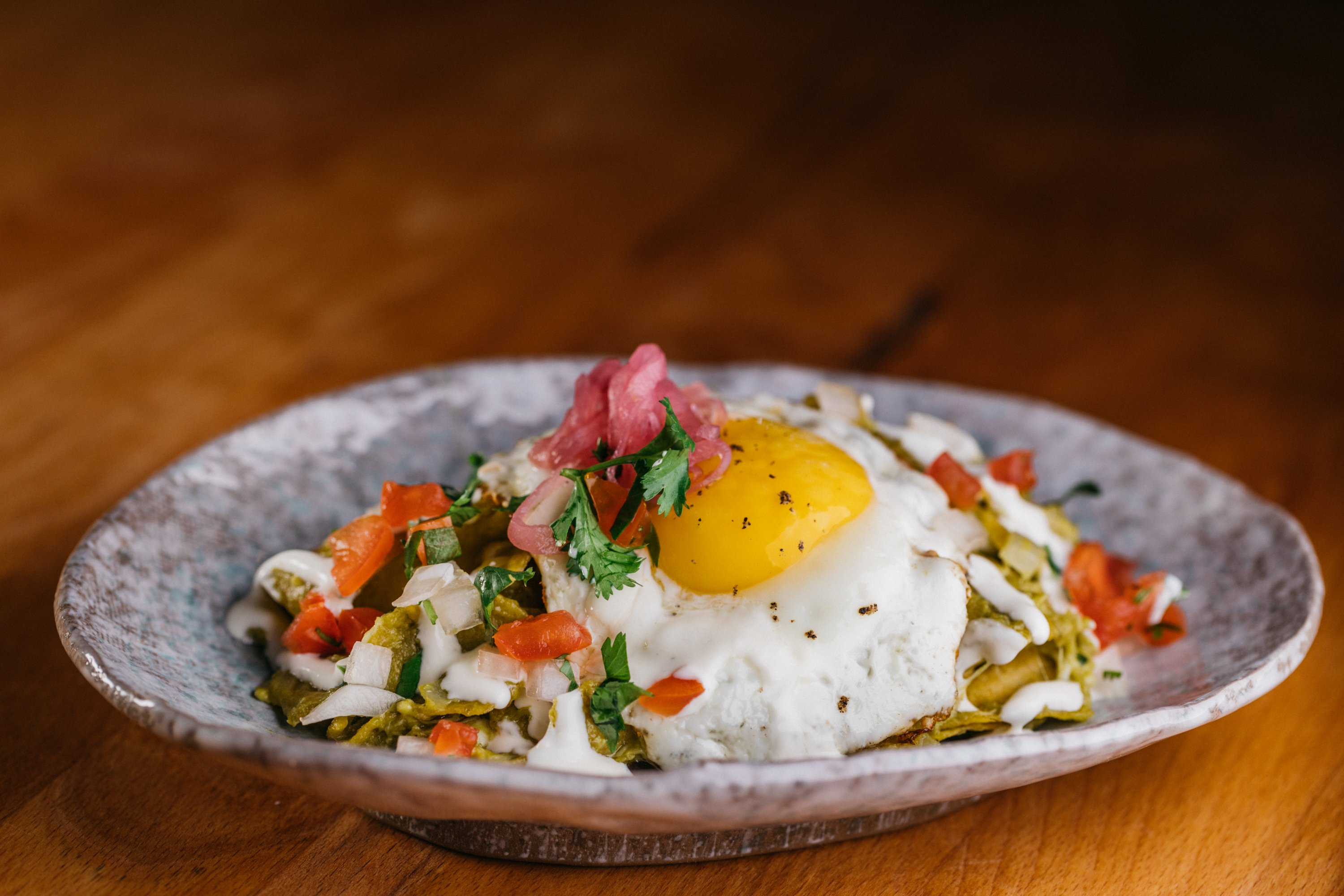 Chilaquiles are part of Buena Vida's unlimited small plates deal. Photograph courtesy of Buena Vida.