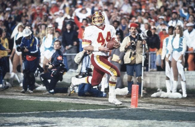 Riggo rushing in his famous 43-yard touchdown against the Miami Dolphins. Photograph by Tony Tomsic/Sports Illustrated/Getty Images.