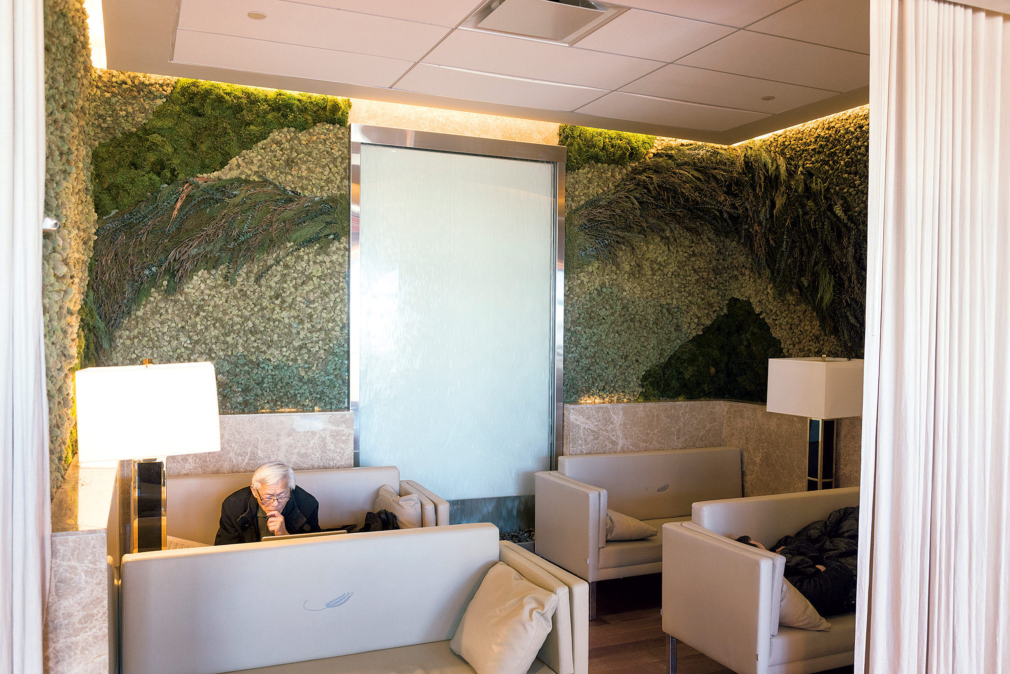 The Turkish Airlines lounge at Dulles features a moss wall and a waterfall, sushi at the buffet, and freshly made baklava. Photograph by Lauren Bulbin.