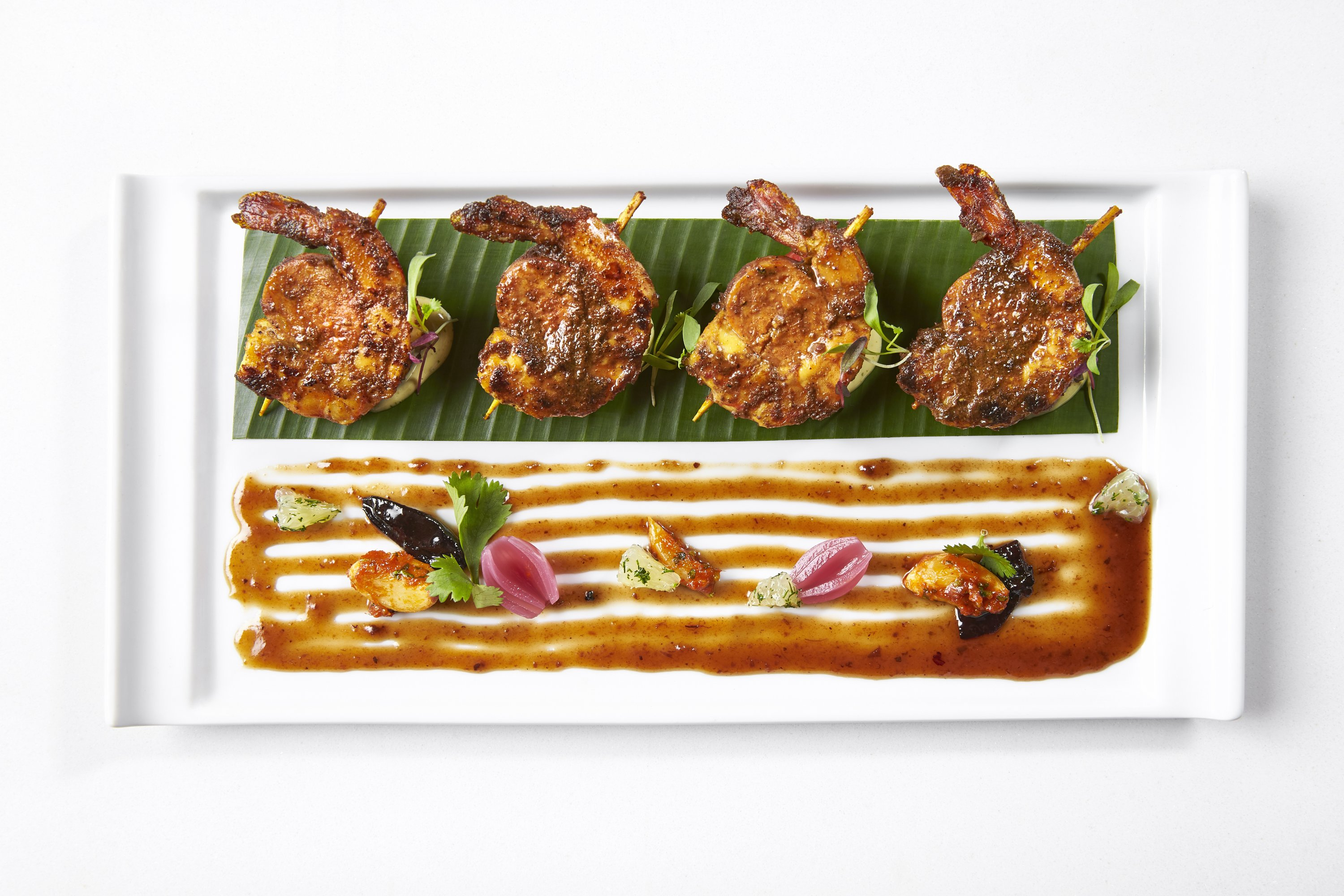 Skewers marry chicken chorizo and shrimp with flavors from Goa on the west coast. Photograph by Greg Powers.
